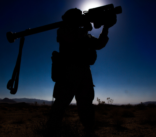 Pvt. Lewis T. Washington, a 14S Air and Missile Defense Trooper with I Troop, 1st Squadron, 11th Armored Cavalry Regiment, uses a Stinger Missile to bring down an Apache Helicopter during a force-on-force engagment against 2nd Brigade, 4th Infantry Division on Fort Irwin, Calif., 23 June 2013.