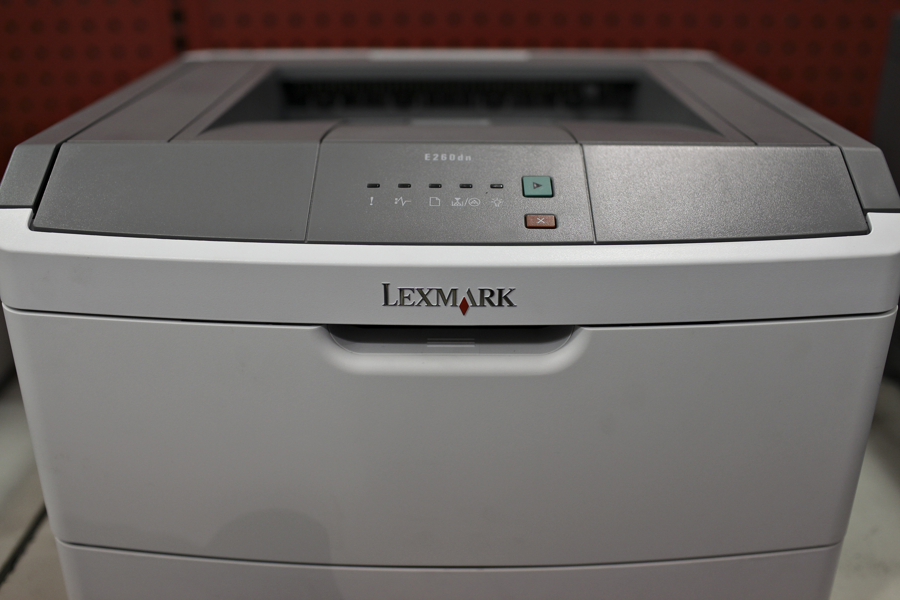 A Lexmark laser printer sits on display inside a Staples sto