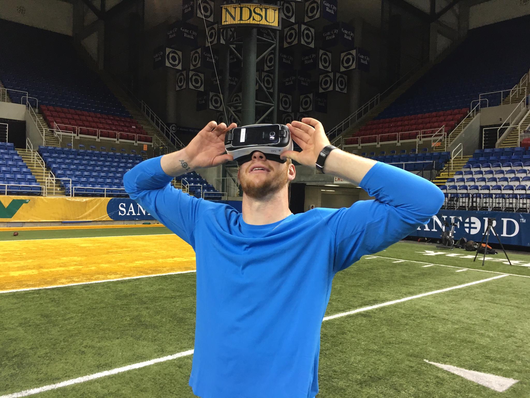 North Dakota State quarterback Carson Wentz checks out virtual reality in Samsung Gear VR.