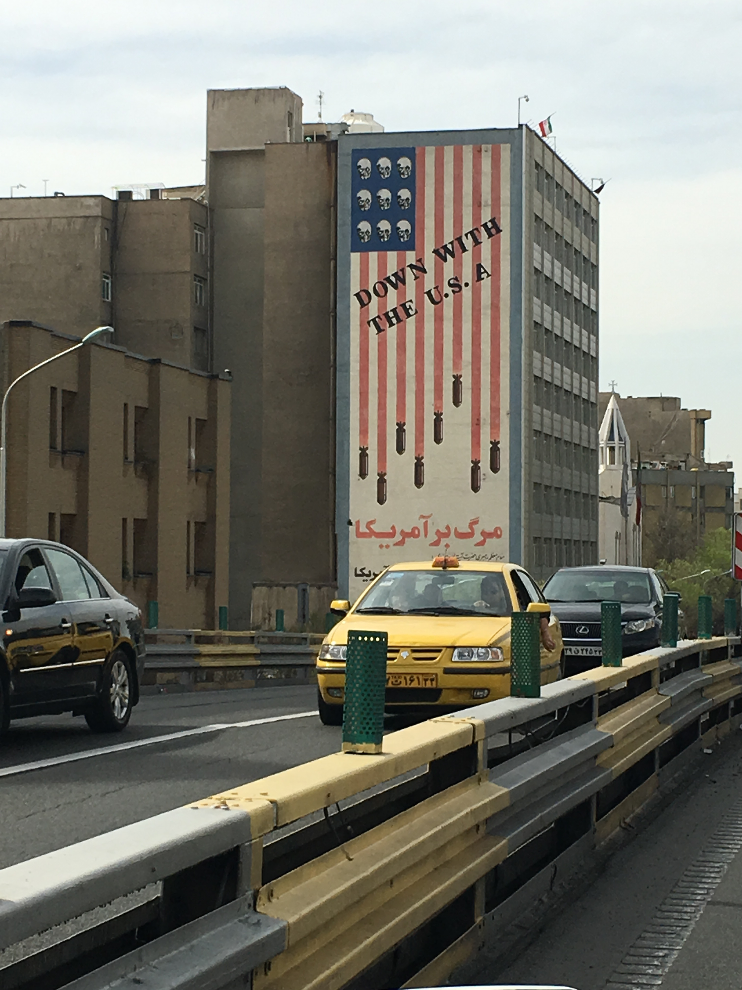 "A revolutionary mural in Tehran shows bombs and skulls on the US flag, with the words, ""We will not compromise with America, even for one second."" The decades-old mural has remained, despite Iran's nuclear deal with the West."