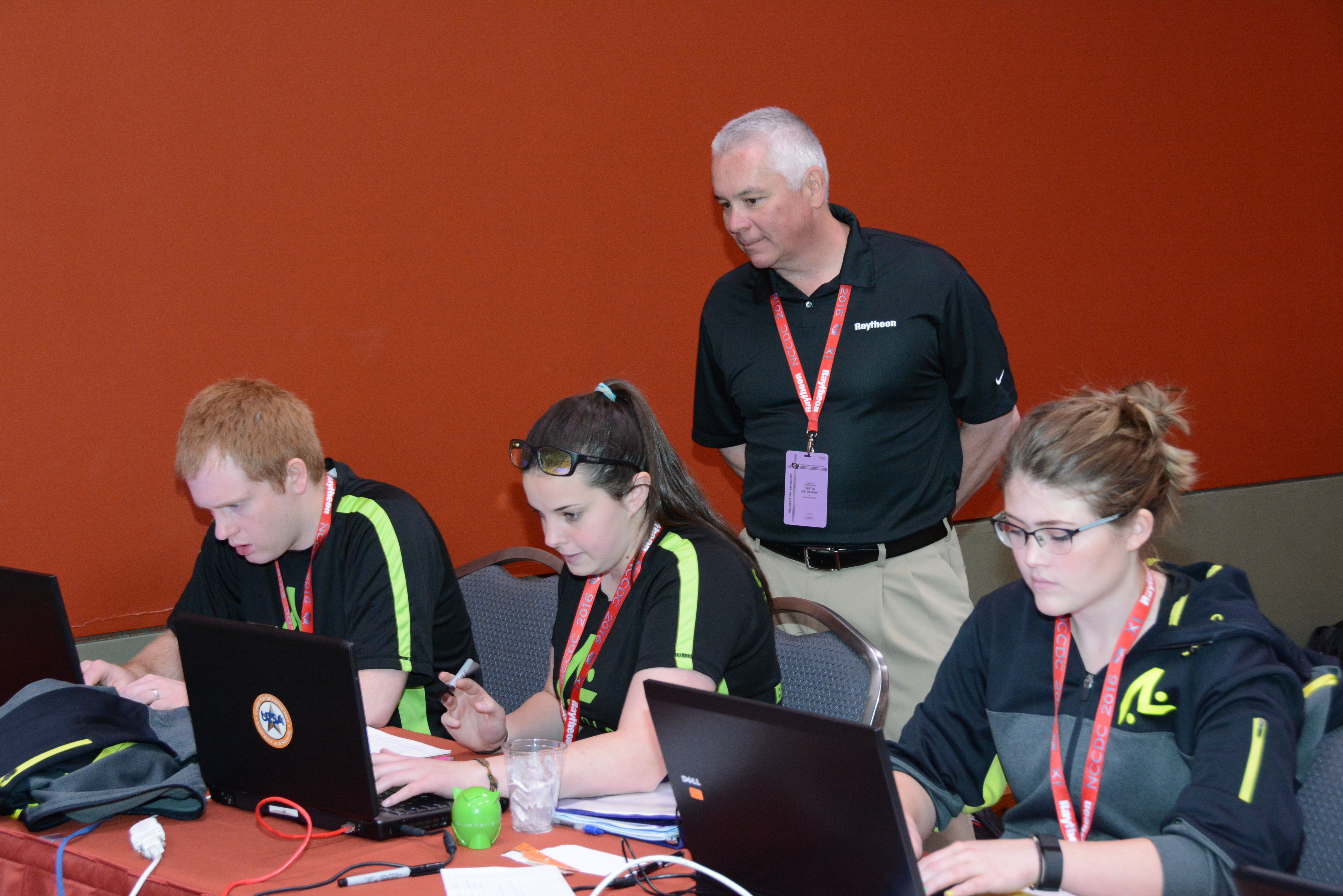 Brigham Young University team members with Raytheon's Jack Harrington at the National Collegiate Cyber Defense Championship.