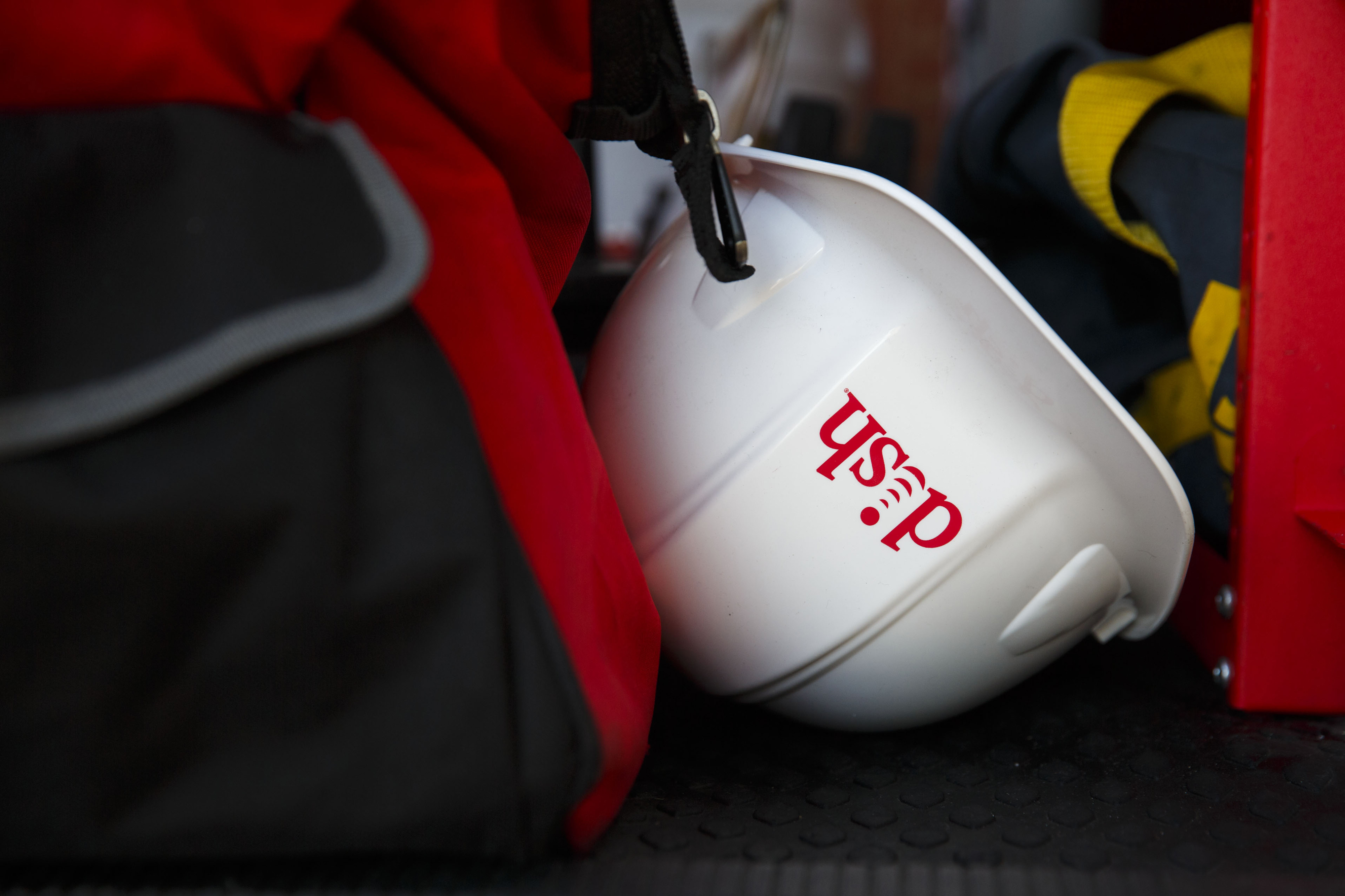 The Dish Network Corp. logo is displayed on a hard hat during a installation in Paramount, California, U.S., on Tuesday, November 3, 2015. Photographer: Patrick T. Fallon/Bloomberg