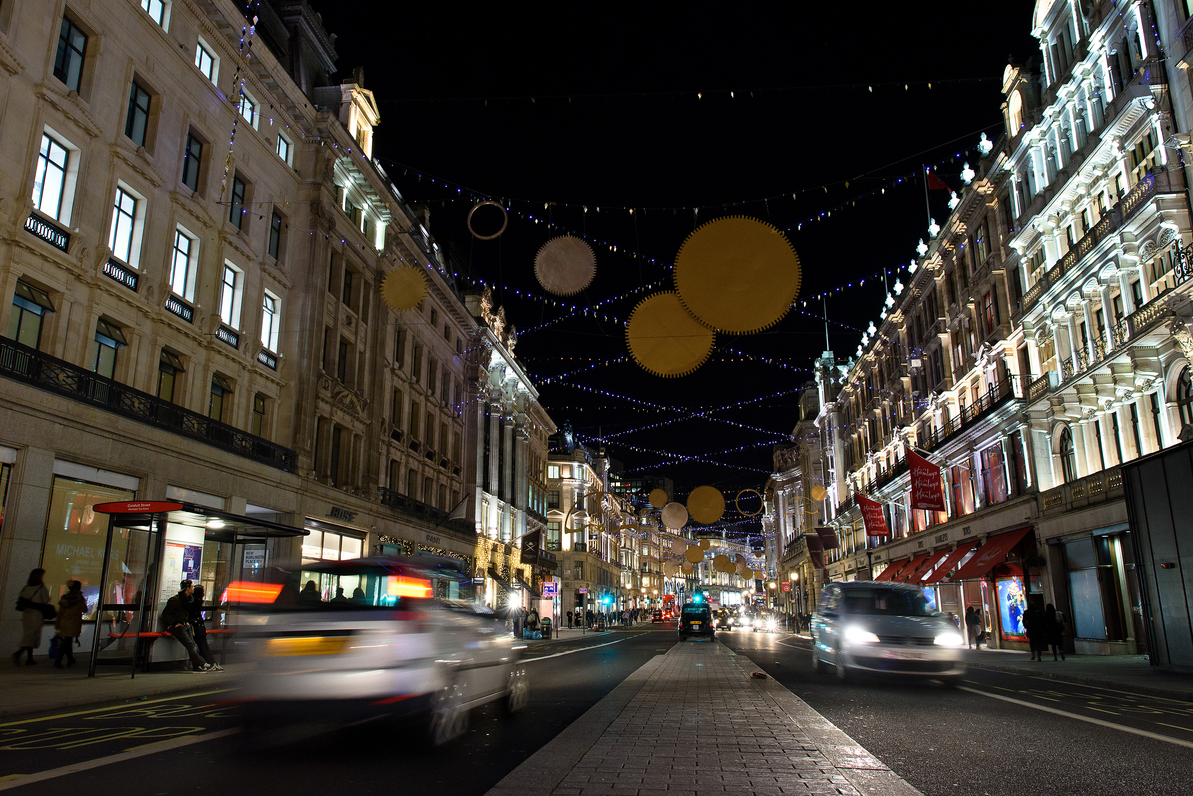 LONDON, ENGLAND - DECEMBER 08: Regent Street displays a series of golden sequins, cogs and coils as part of it's Christmas light display on December 8, 2015 in London, England. British retailers are hoping for a rise in sales over the Christmas period after November's Black Friday sales failed to boost turnover. (Photo by Ben Pruchnie/Getty Images)