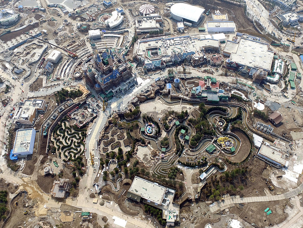 SHANGHAI, CHINA - FENRUARY 25: (CHINA OUT) Aerial view from an Unmanned Aerial Vehicle (UAV) shows Shanghai Disneyland Park is under construction on February 25, 2016 in Shanghai, China. Shanghai Disney Resort, a one-of-a-kind destination featuring Shanghai Disneyland which is the 6th in the world, 2 Resort hotels, Disneytown, Wishing Star Park and more, will welcome its grand opening on June 16, 2016. (Photo by VCG)***_***