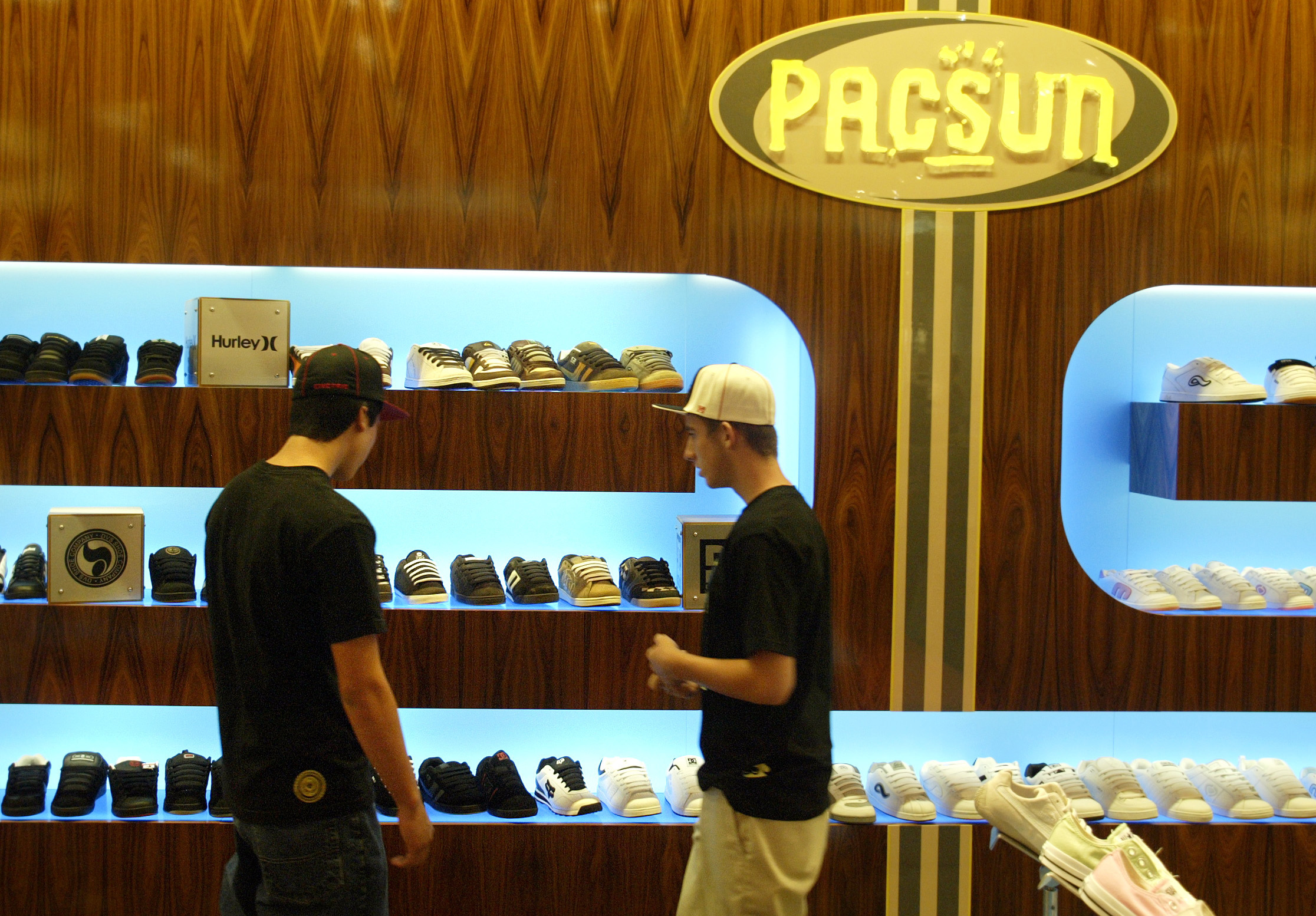 Shoppers look over the shoe department at the new Pacsun store at the Galleria in Riverside. Pacifi