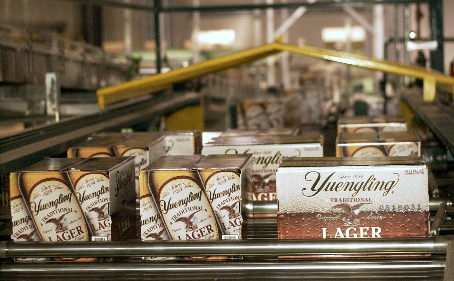 Cases of lager roll off the assembly line at the Yuengling b