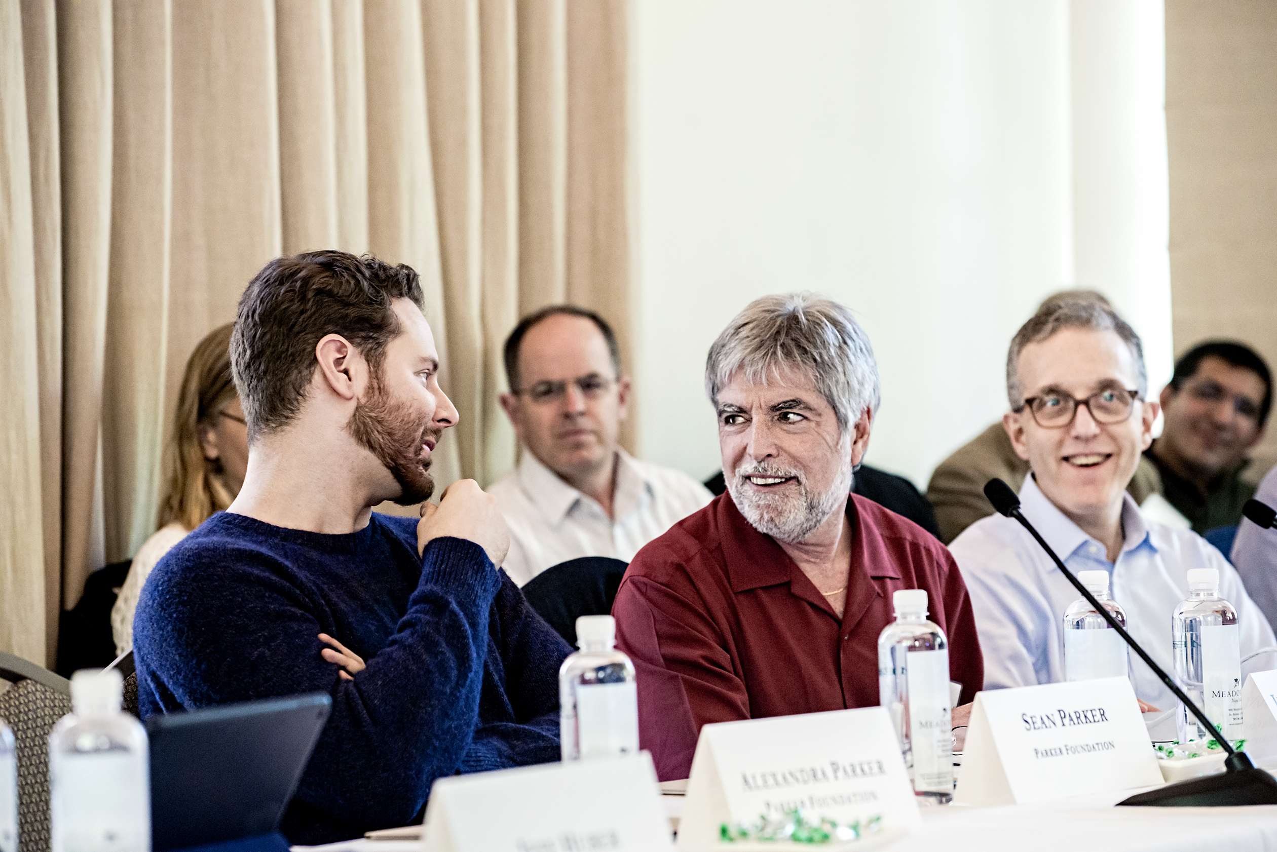 Tech Entrepeneur Sean Parker (left) talks to Jeff Bluestone (center), CEO and president of the Parker Institute for Cancer Immunotherapy, during a retreatat the Meadowood resort in St. Helena, CA.Photo by Winni Wintermeyer for Fortune. April 4, 2016.