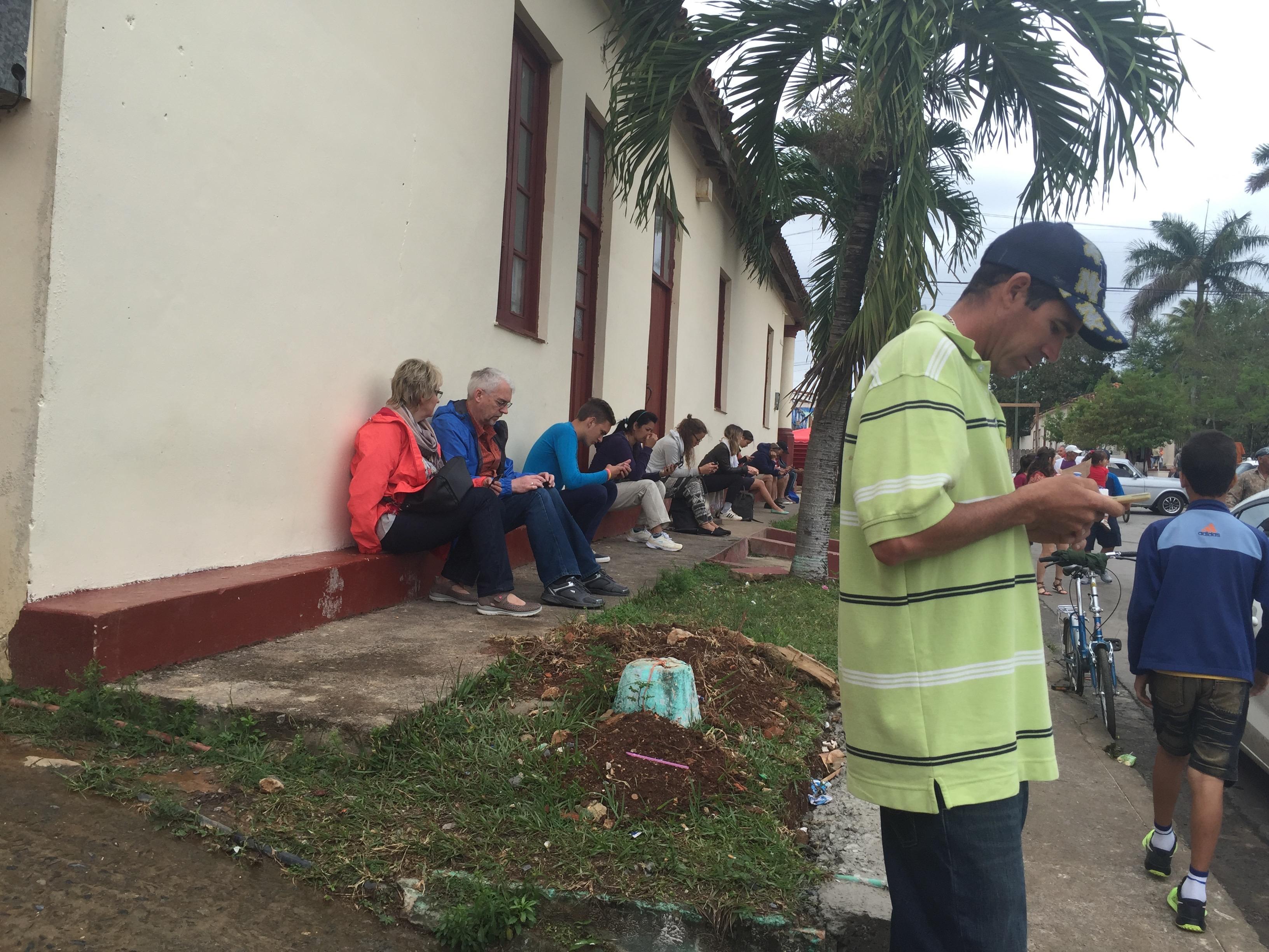 Wi-Fi users near an internet kiosk in Havana, Cuba.