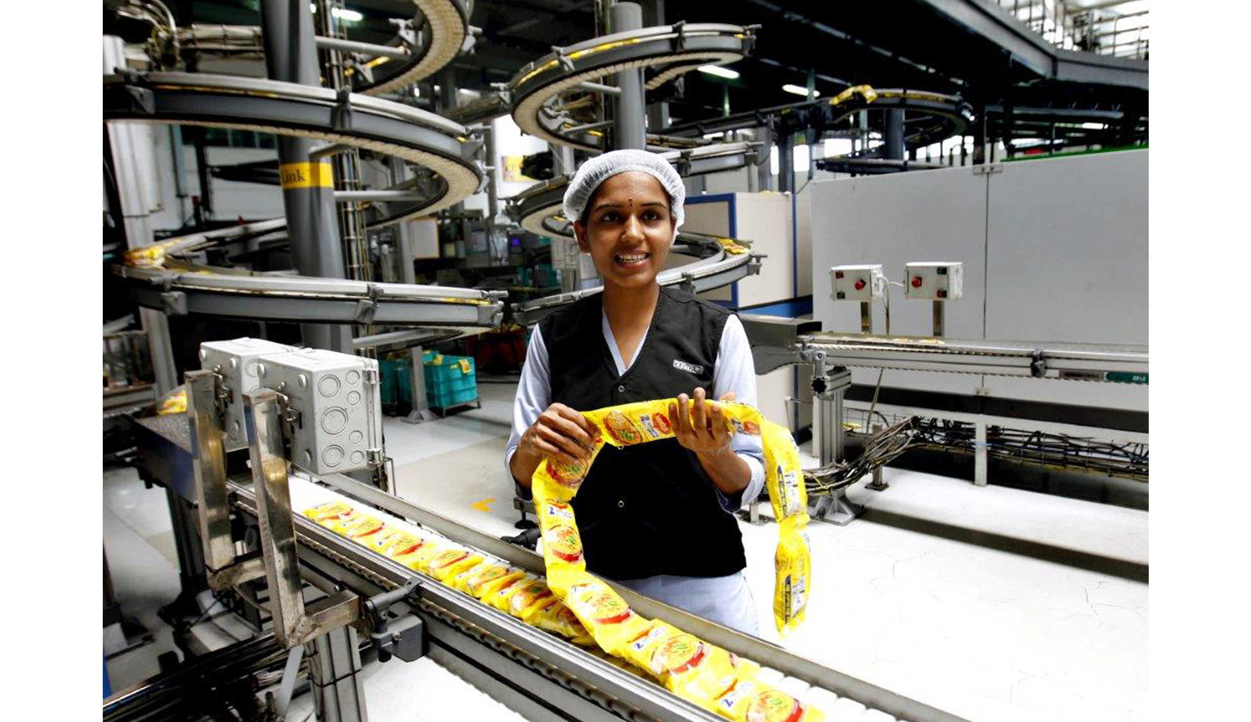 Maggi Noodles come off the manufacturing line after the ban lifted in one of Nestle's 5 Indian factories.