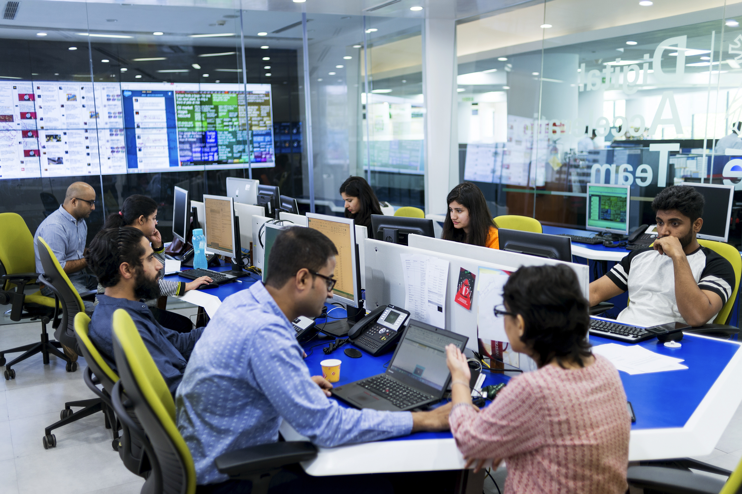 "Employees in Nestlé India's ""digital acceleration"" room monitor social media."