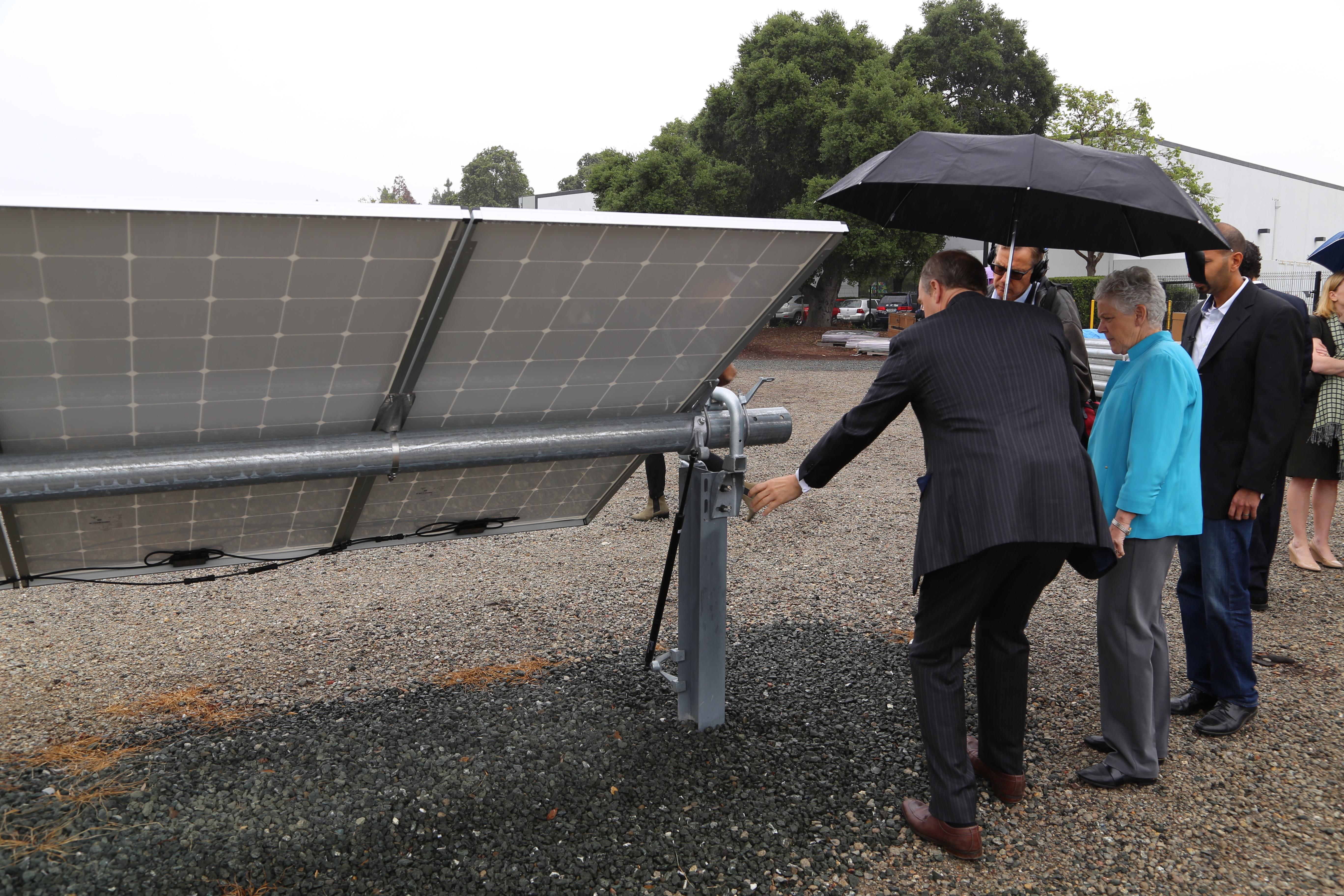 The CEO of NEXTracker Dan Shugar shows EPA head Gina McCarthy NEXTracker's solar tracker technology.