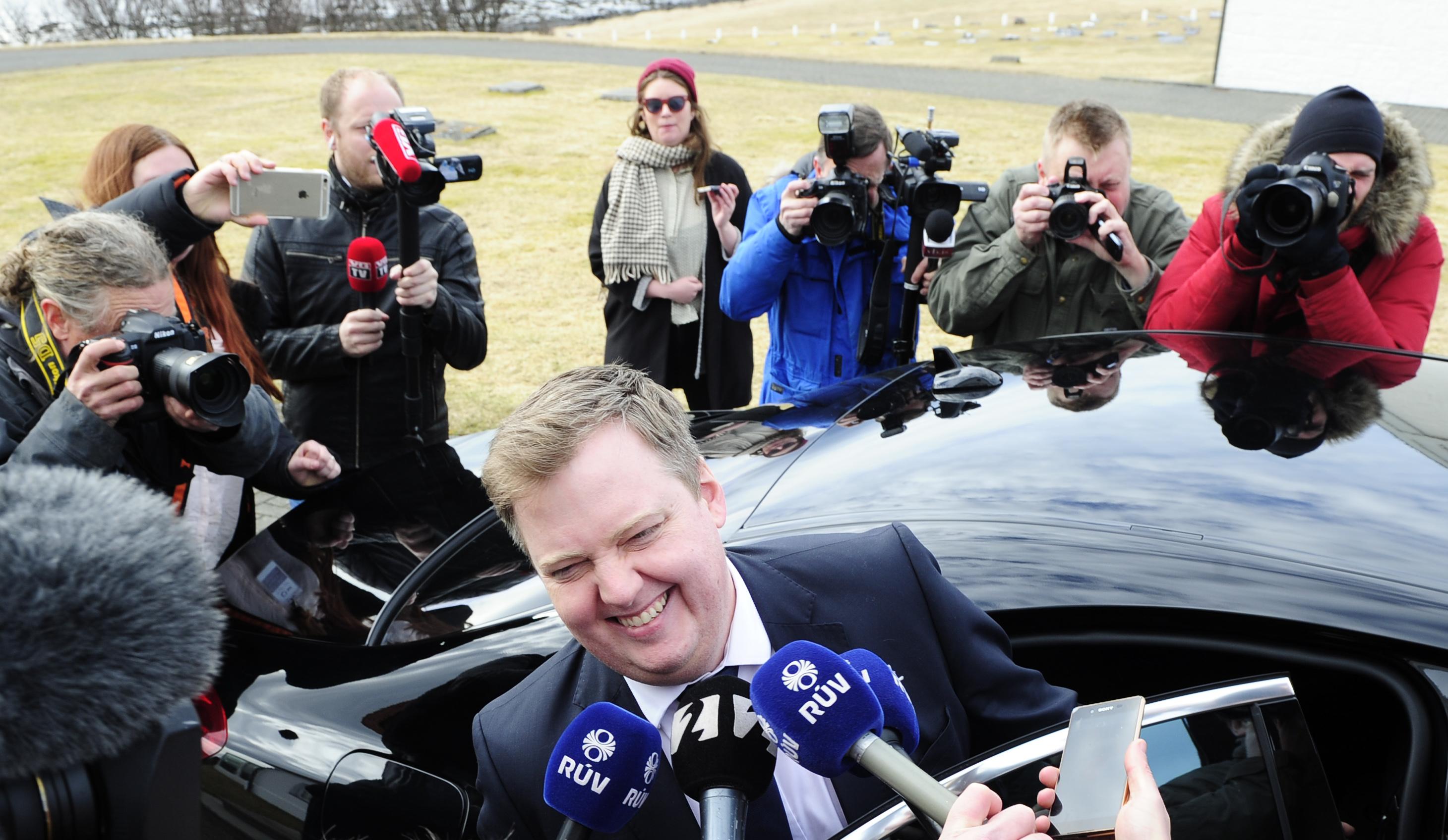 Iceland's Prime Minister Gunnlaugsson speaks to media outside Iceland president's residence in Reykjavik