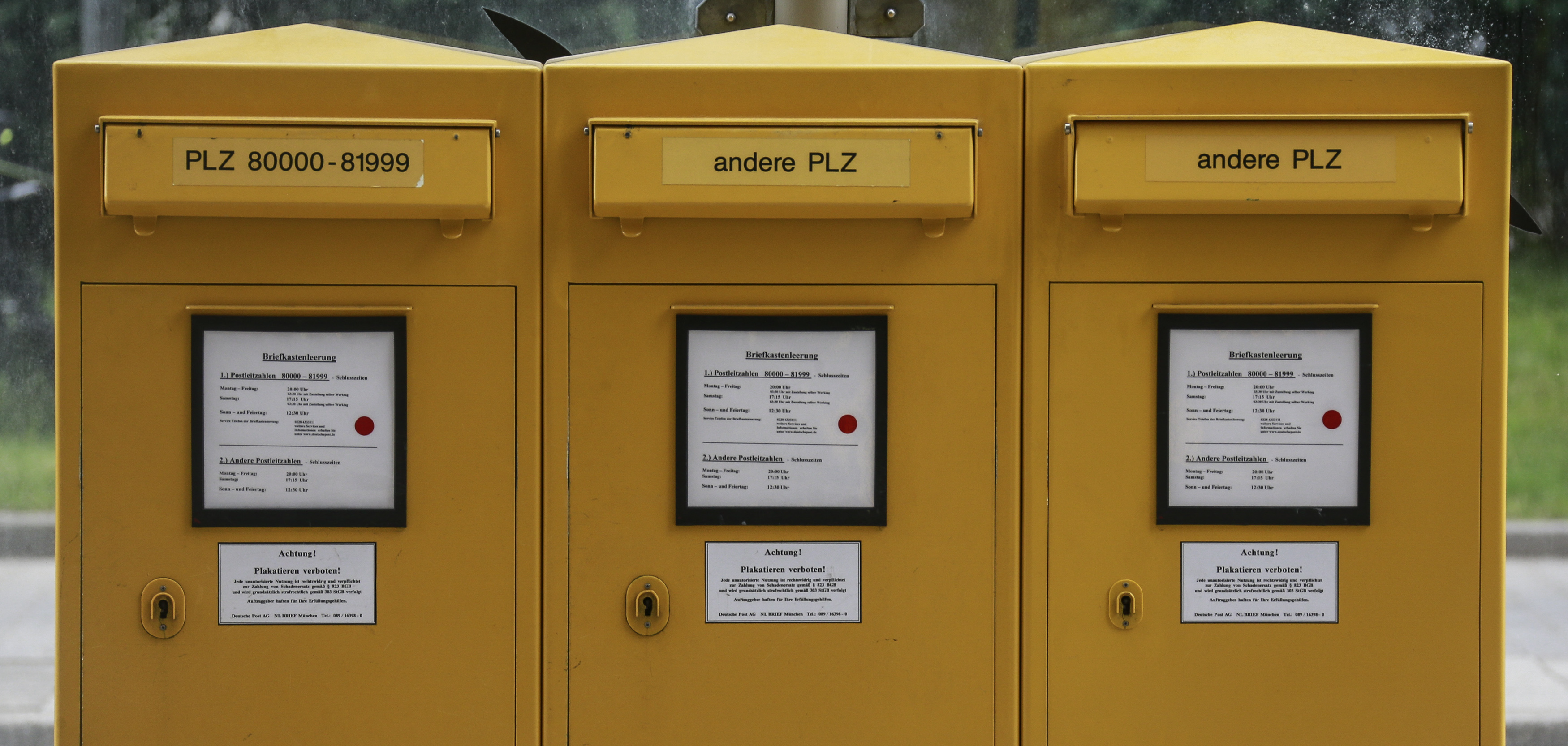 Letterboxes of German mail carrier Deutsche Post are seen during a demonstration in Munich
