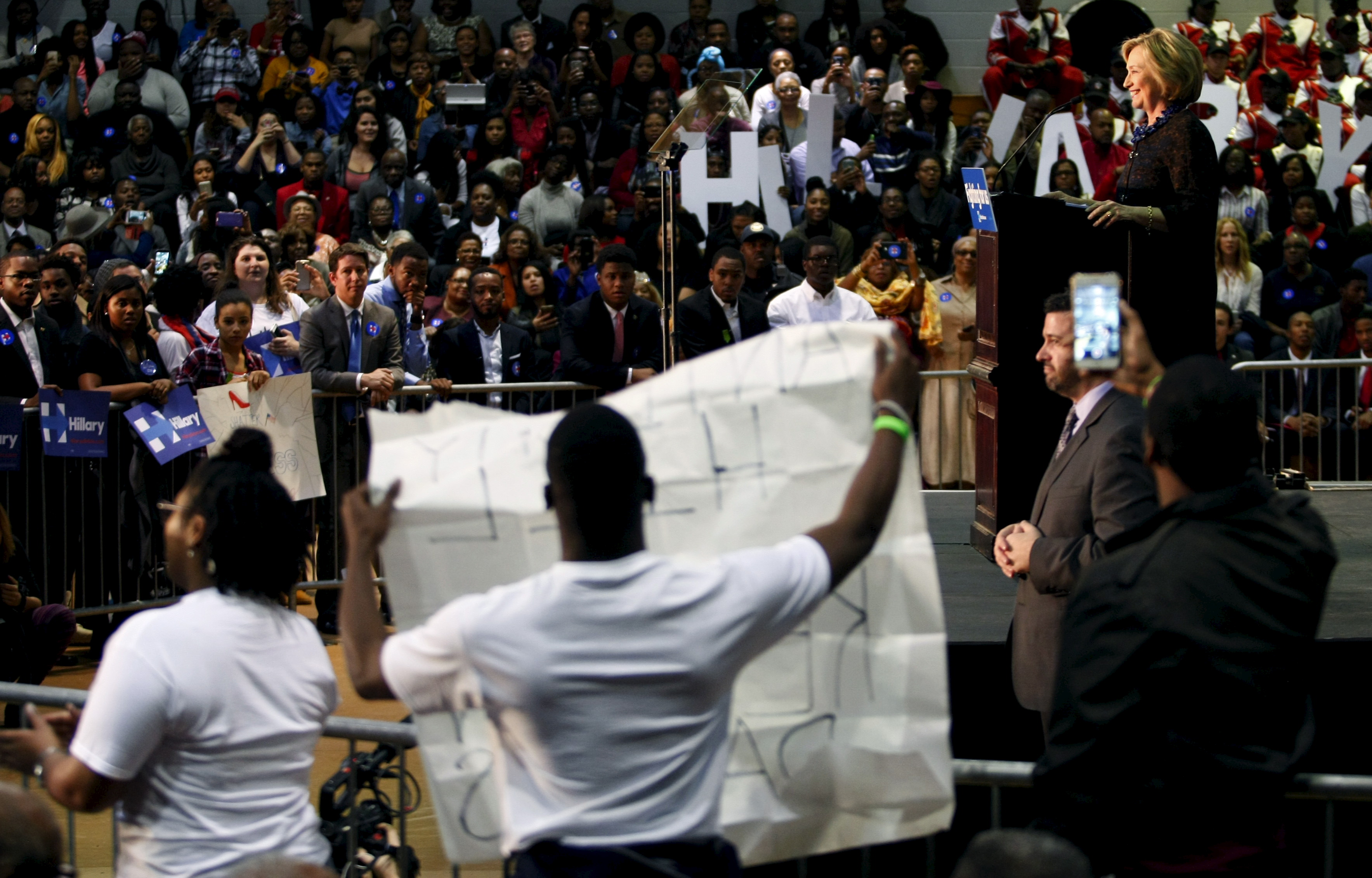 """U.S. Democratic presidential candidate Hillary Clinton speaks at the """"African Americans for Hillary"""" rally as protesters from """"Black Lives Matter"""" interrupt her speech at Clark Atlanta University in Atlanta, Georgia"""