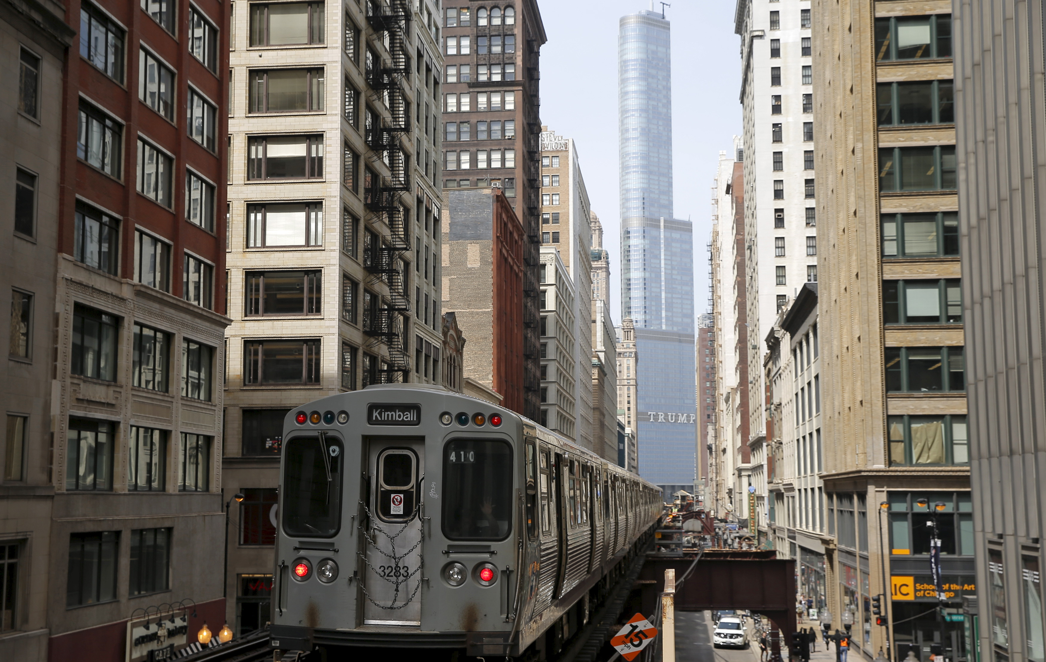 A subway car rides along the tracks towards The Trump International Hotel and Tower in downtown Chicago
