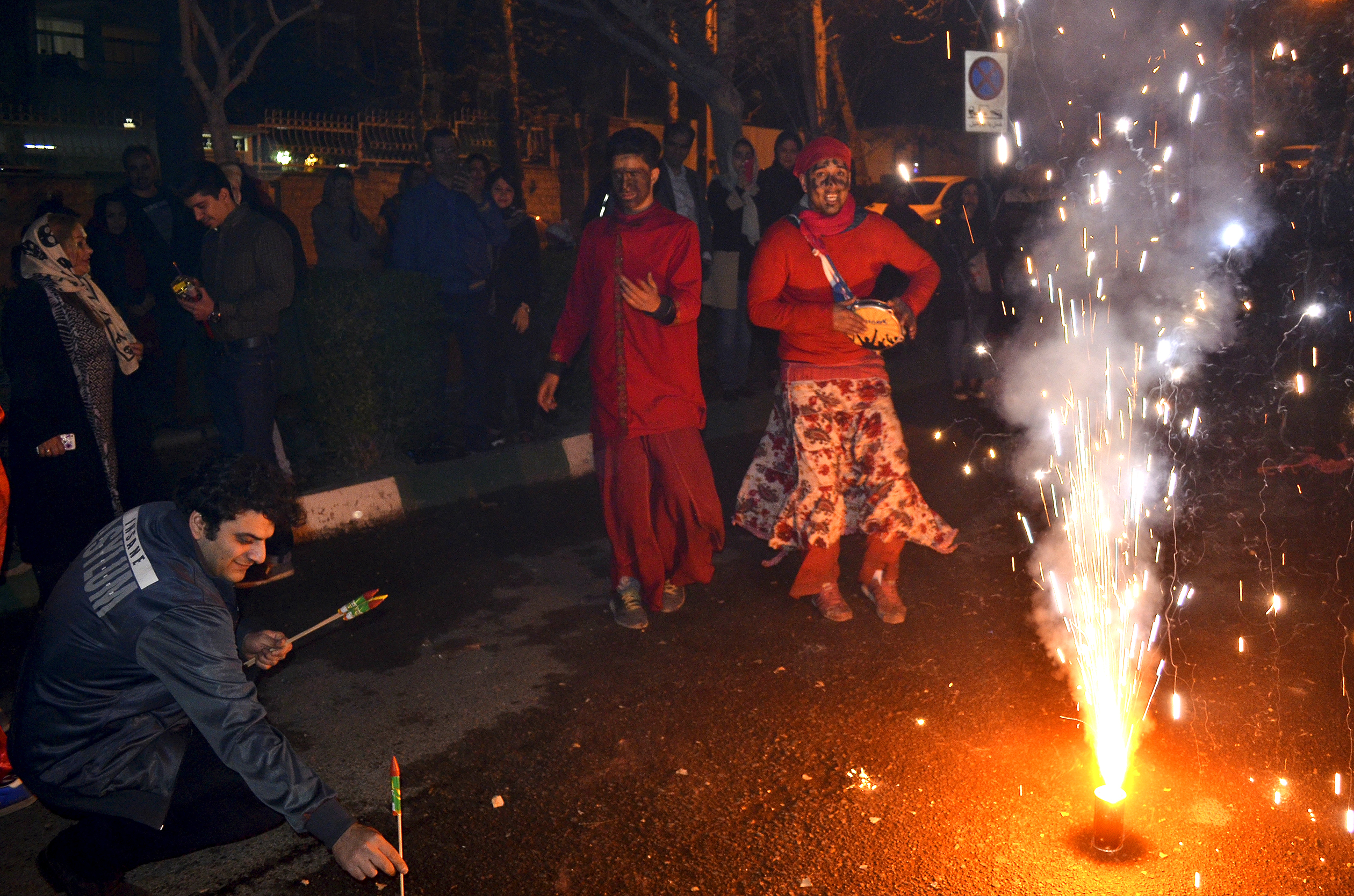 "Iranian celebrate Chaharshanbeh Soori, a traditional ""fire feast"", on the streets in Tehran."