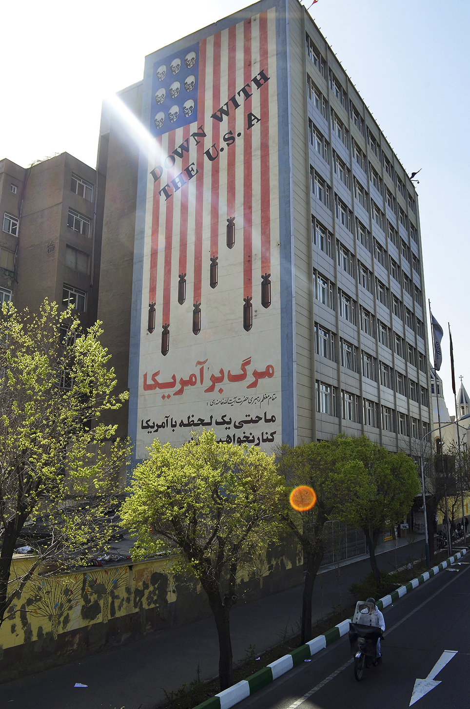 "Symbols of antipathy to the U.S. coexist with signs of a yearning for a Western lifestyle. The Persian text read ""Iran will not deal with America even for a second"""