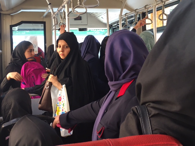 The women's-only section on a Tehran bus. Since Iran's strict Islamic laws limit casual contact between the sexes, men and women ride separately.