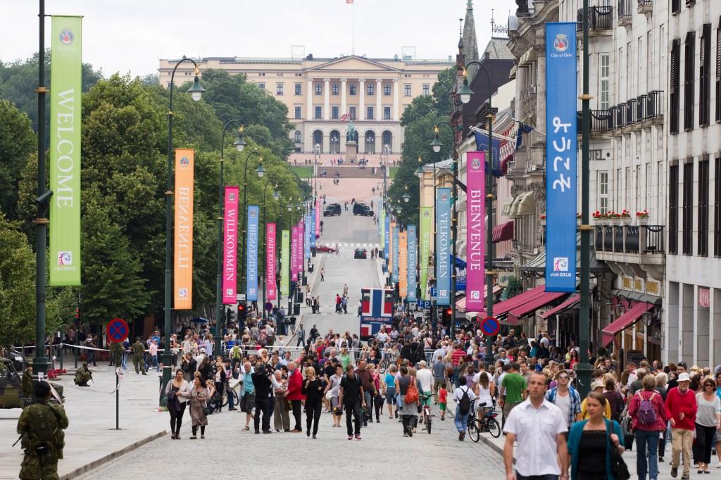 People walk in the main street of Oslo,
