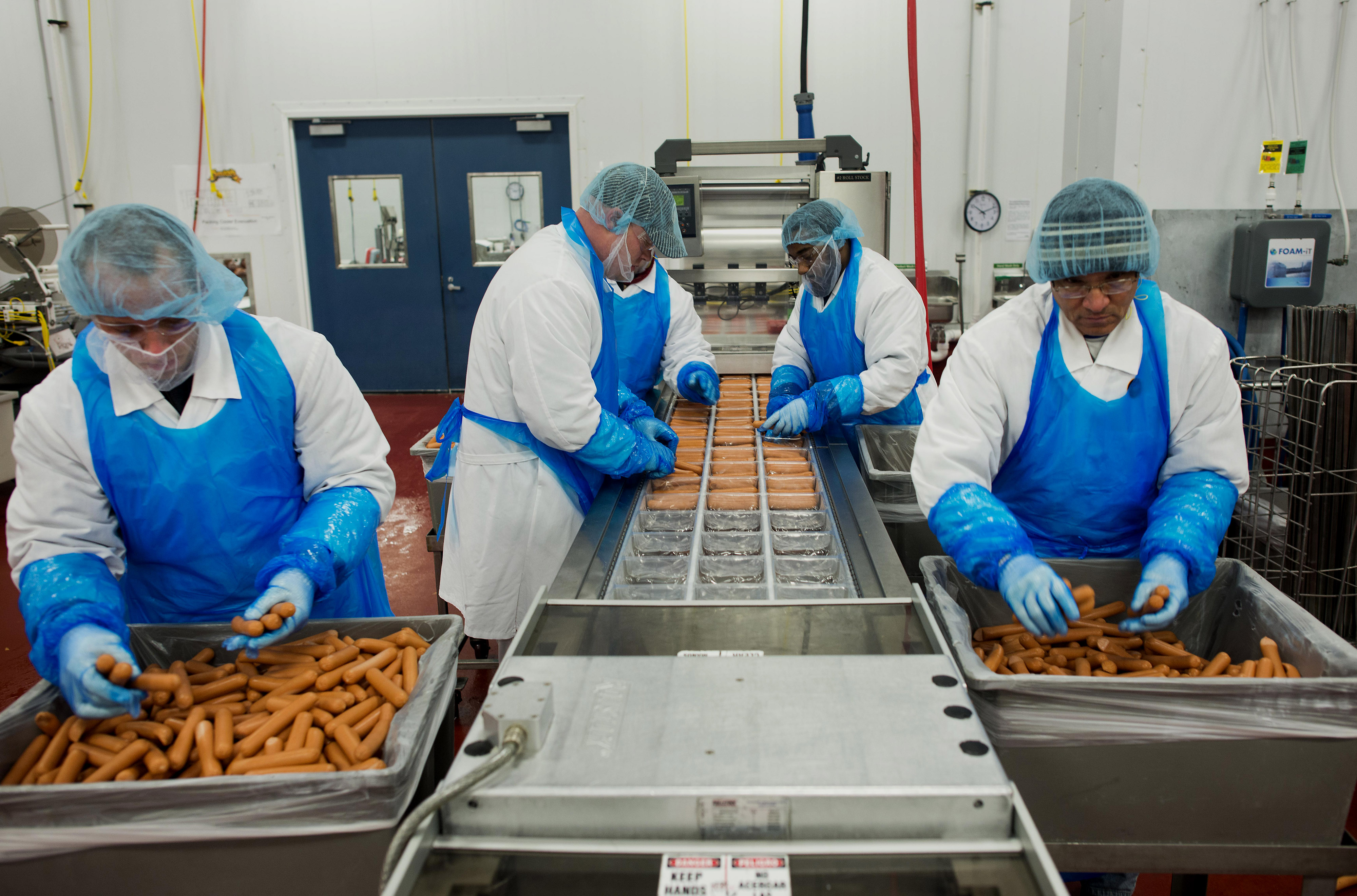 Hot Dog Production At Smith Provisions Co. As US Beef And Pork Exports Fall