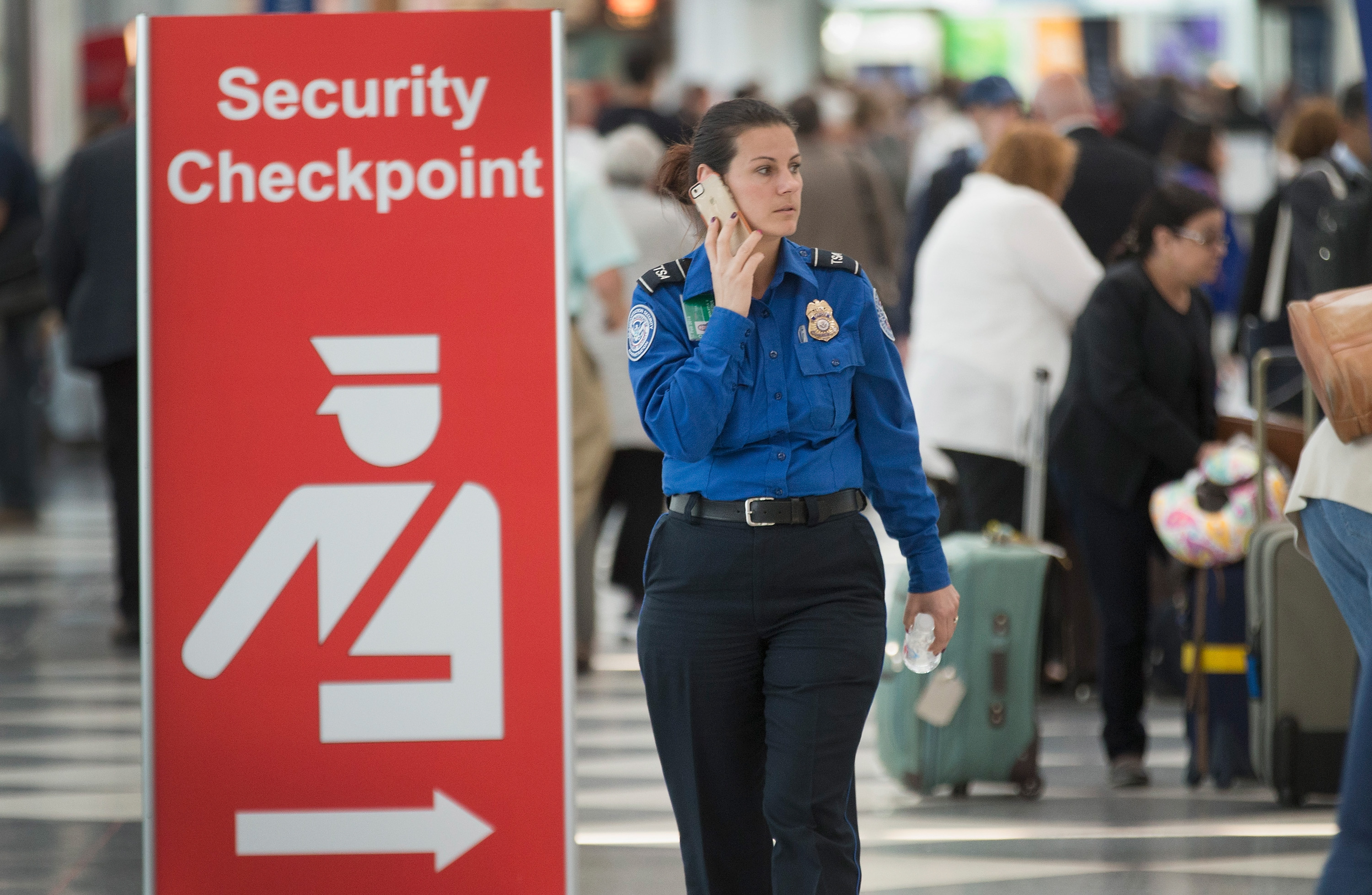 A security checkpoint staffed by TSA workers at Chicago's O'Hare Airport