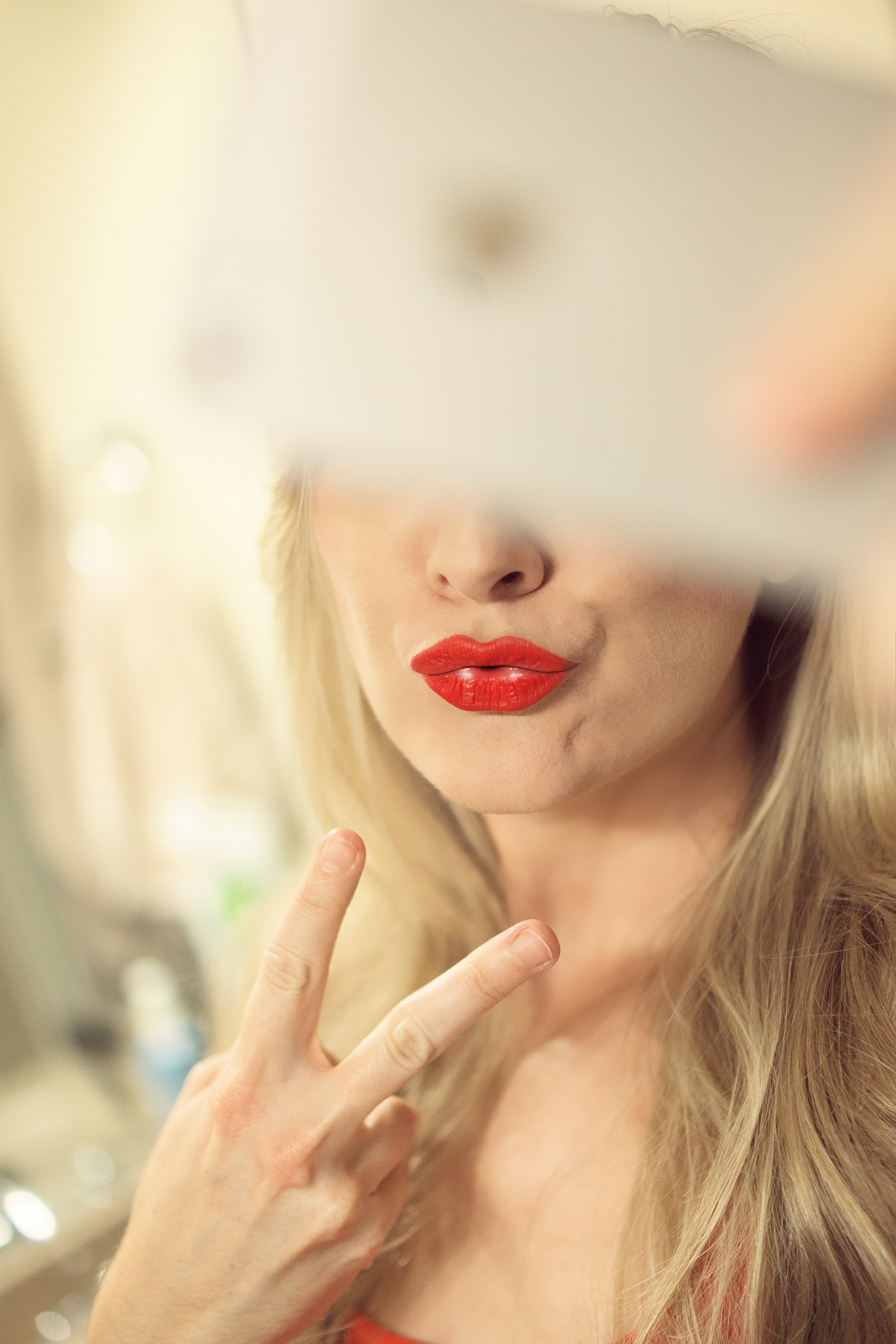 "Girl takes a selfie with a ""duck face"""