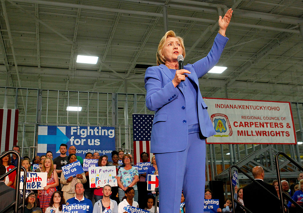 LOUISVILLE, KY - MAY 15: Democratic presidential candidate Hillary Clinton addresses the crowd during a campaign stop at the Union of Carpenters and Millwrights Training Center May 15, 2016 in Louisville, Kentucky. Clinton is preparing for Kentucky's May 17th primary.    (Photo by John Sommers II/Getty Images)