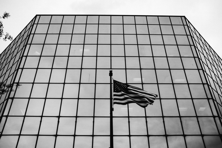 Low Angle View Of American Flag Against Building