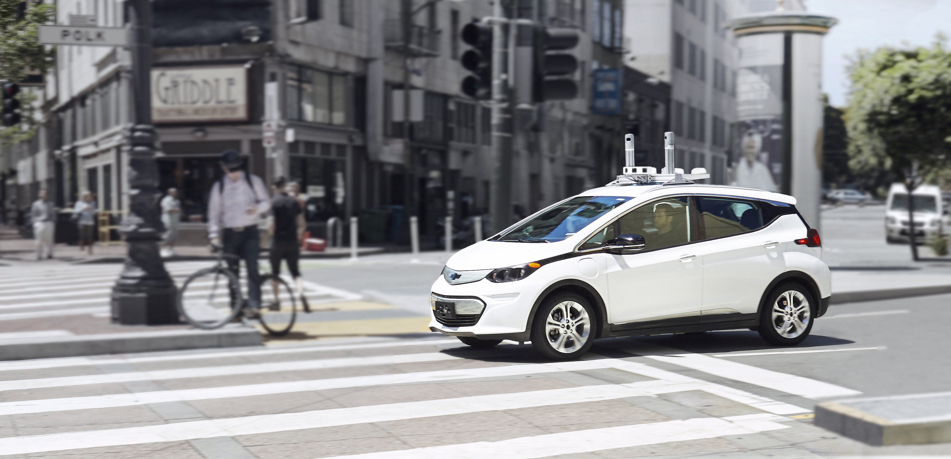 A Chevy Bolt equipped with self-driving technology cruises the streets of San Francisco.