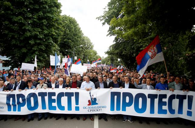 People take part in an anti-government protest in Banja Luka