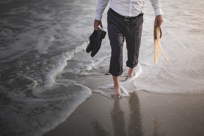 Retired businessman paddling in sea