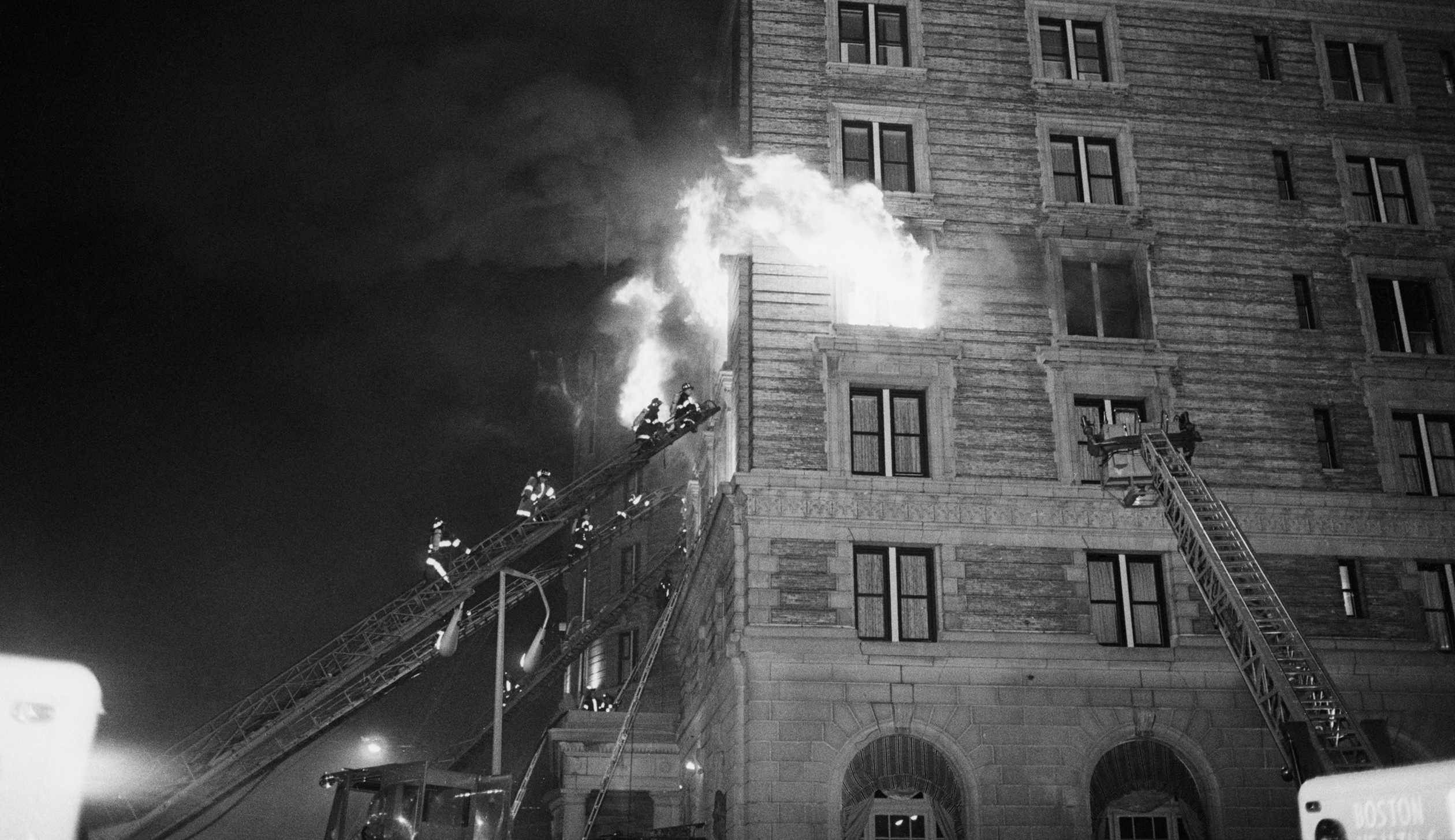 Firemen On Ladder At Flame-Engulfed Wind