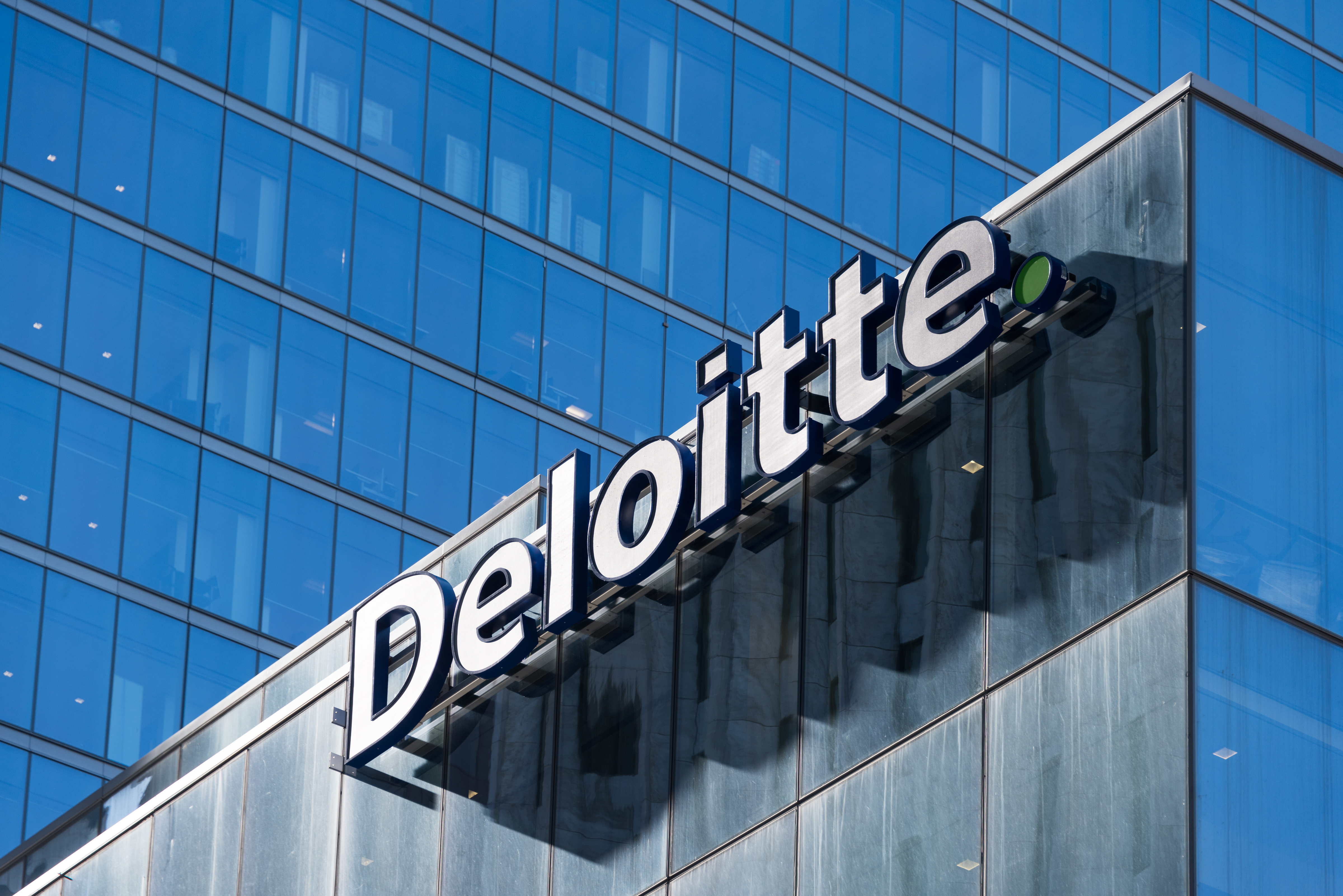 Deloitte sign on top of Toronto headquarters building.