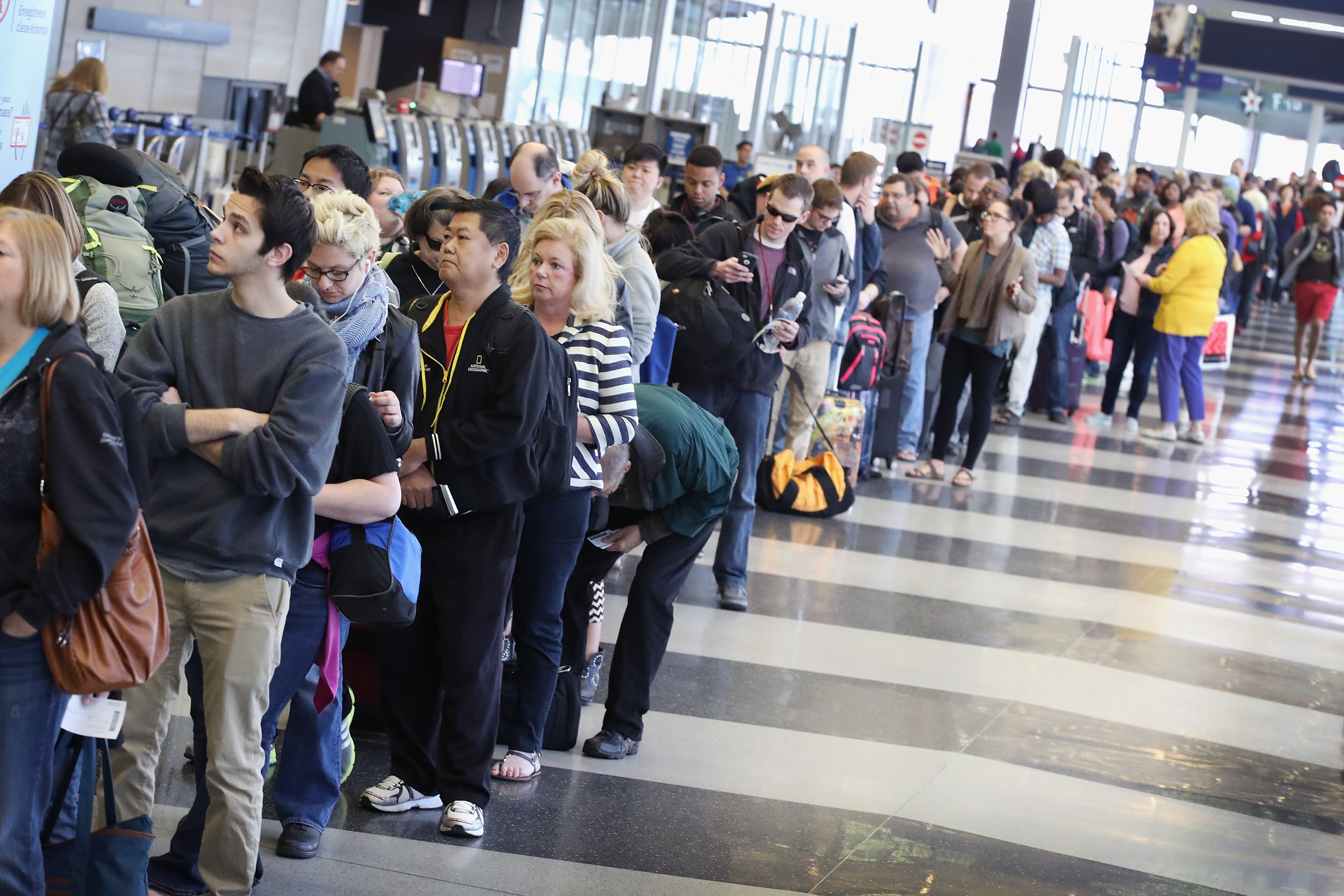 Passengers at O'Hare International Airport await TSA screening