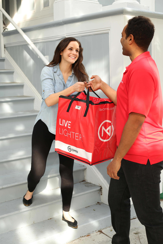 An Omni concierge drops off a customer's items.