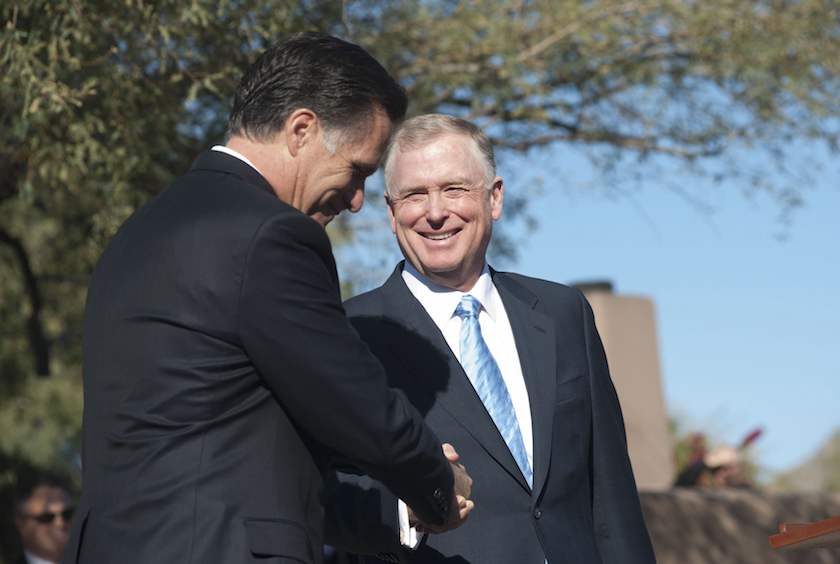 Republican presidential candidate former Massachusetts Governor Romney shakes hands with Former U.S. VP Quayle in Paradise Valley