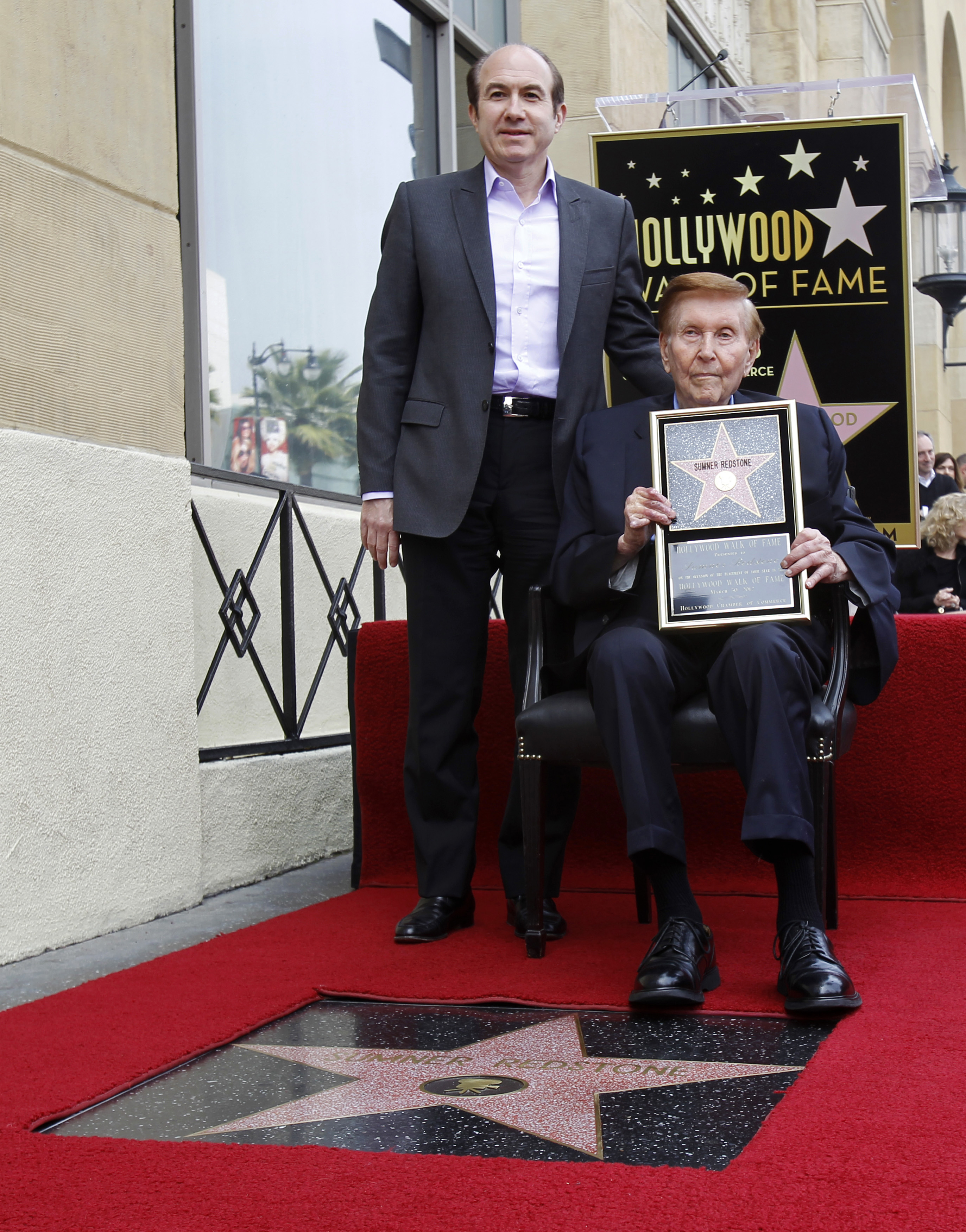 Executive Chairman of Viacom and CBS Corporation Redstone poses after his star was unveiled on the Walk of Fame in Hollywood