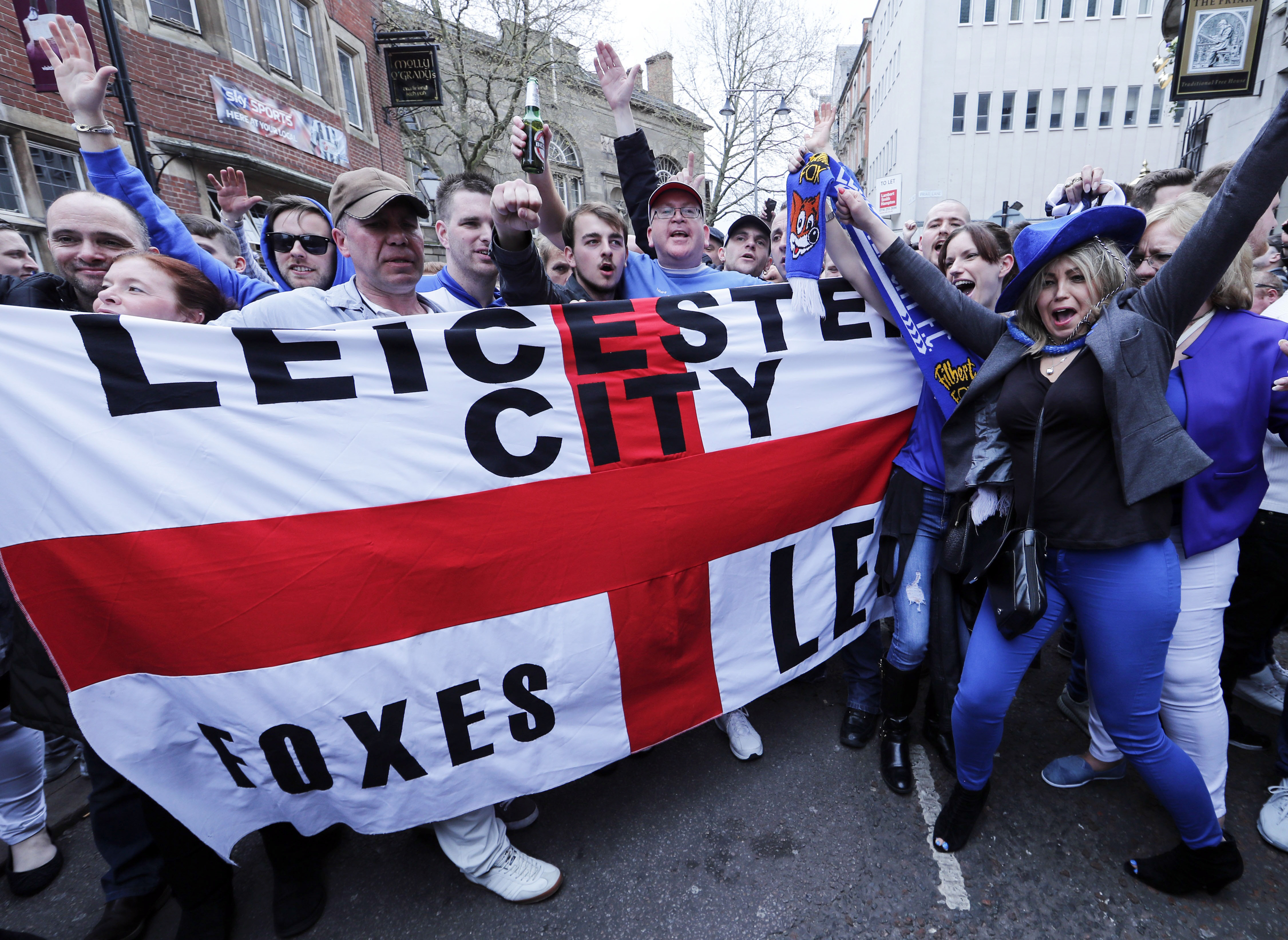 Leicester City fans celebrate in the street after their team's away soccer match against Manchester United, outside Hogarth's pub in Leicester