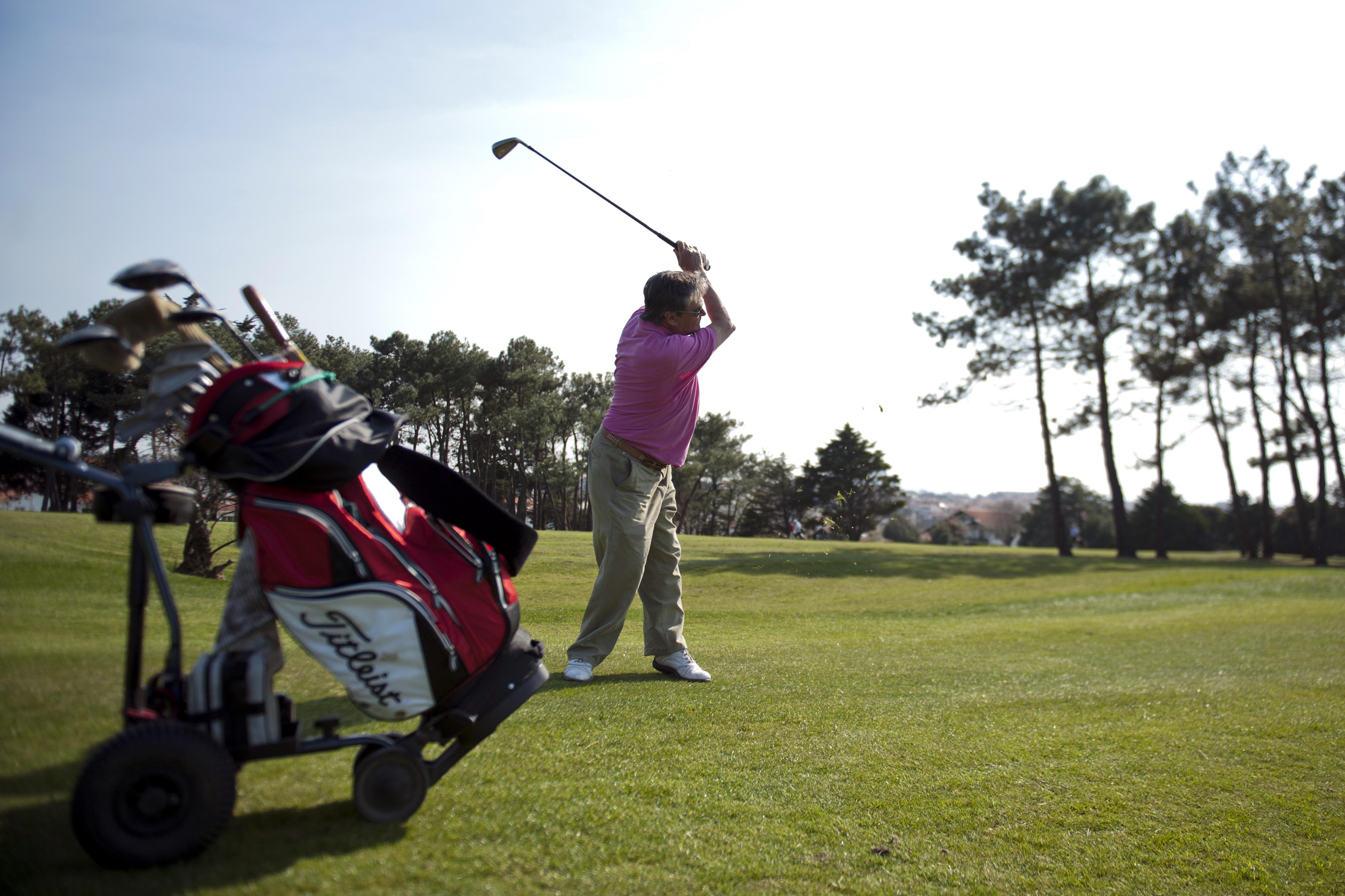 A man plays golf on March 27, 2012 in Bi
