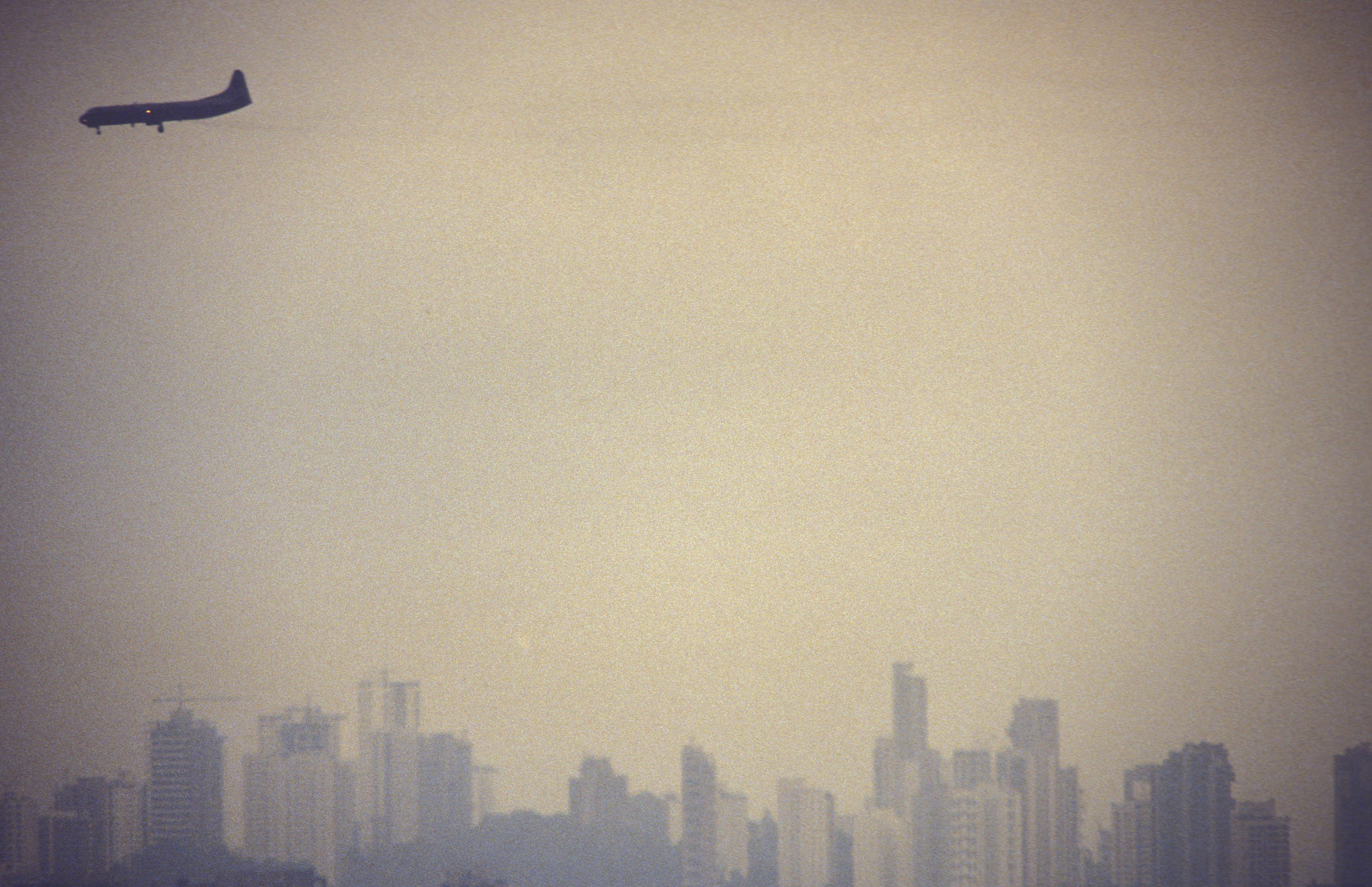 Air pollution. Airplane flies over S?o Paulo city, Brazil