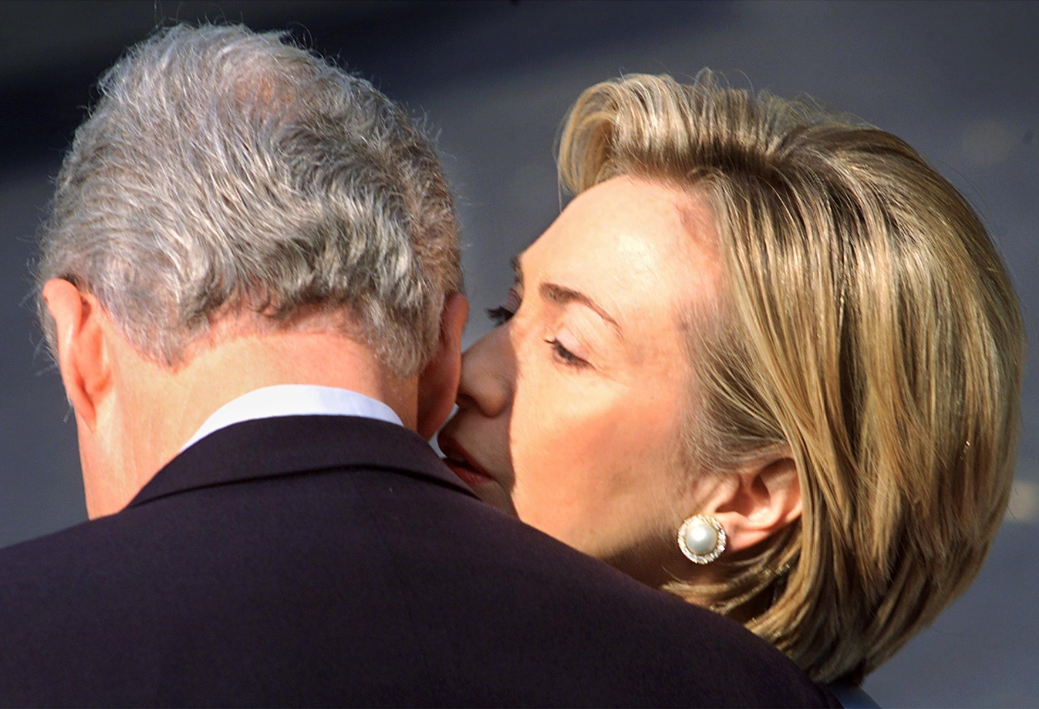US First Lady Hillary Rodham Clinton whispers to U