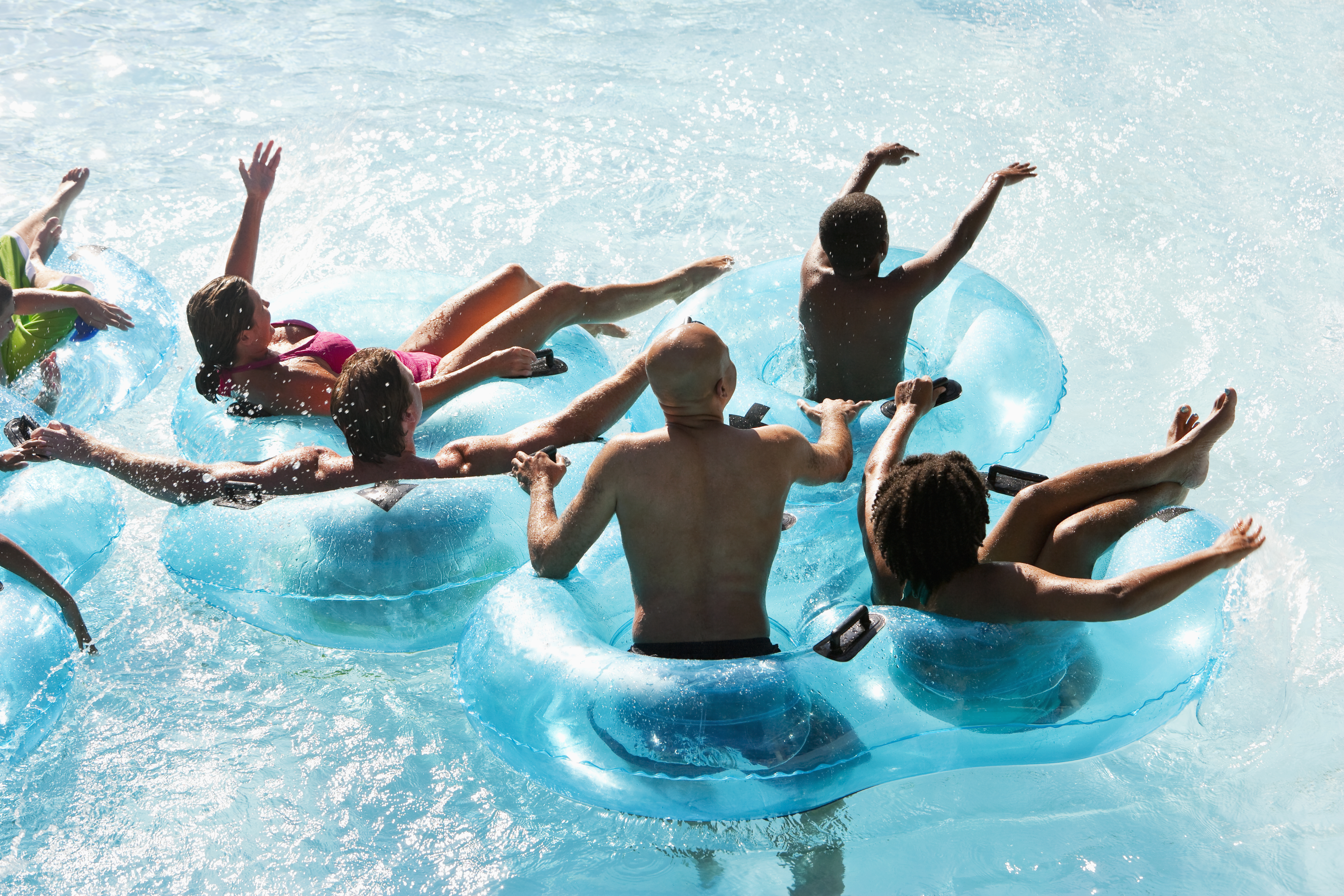 Group of people on innertubes at water park