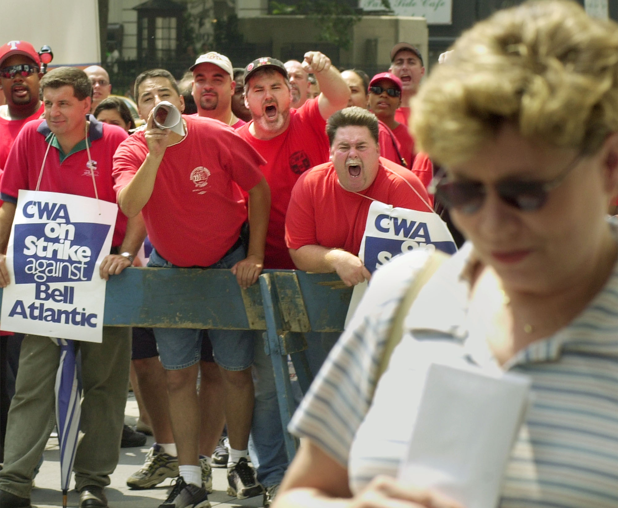 Striking telephone workers represented by the Communications Workers of America verbally harass a woman in front of Verizon Communications'' headquarters in New York Aug. 7, 2000.