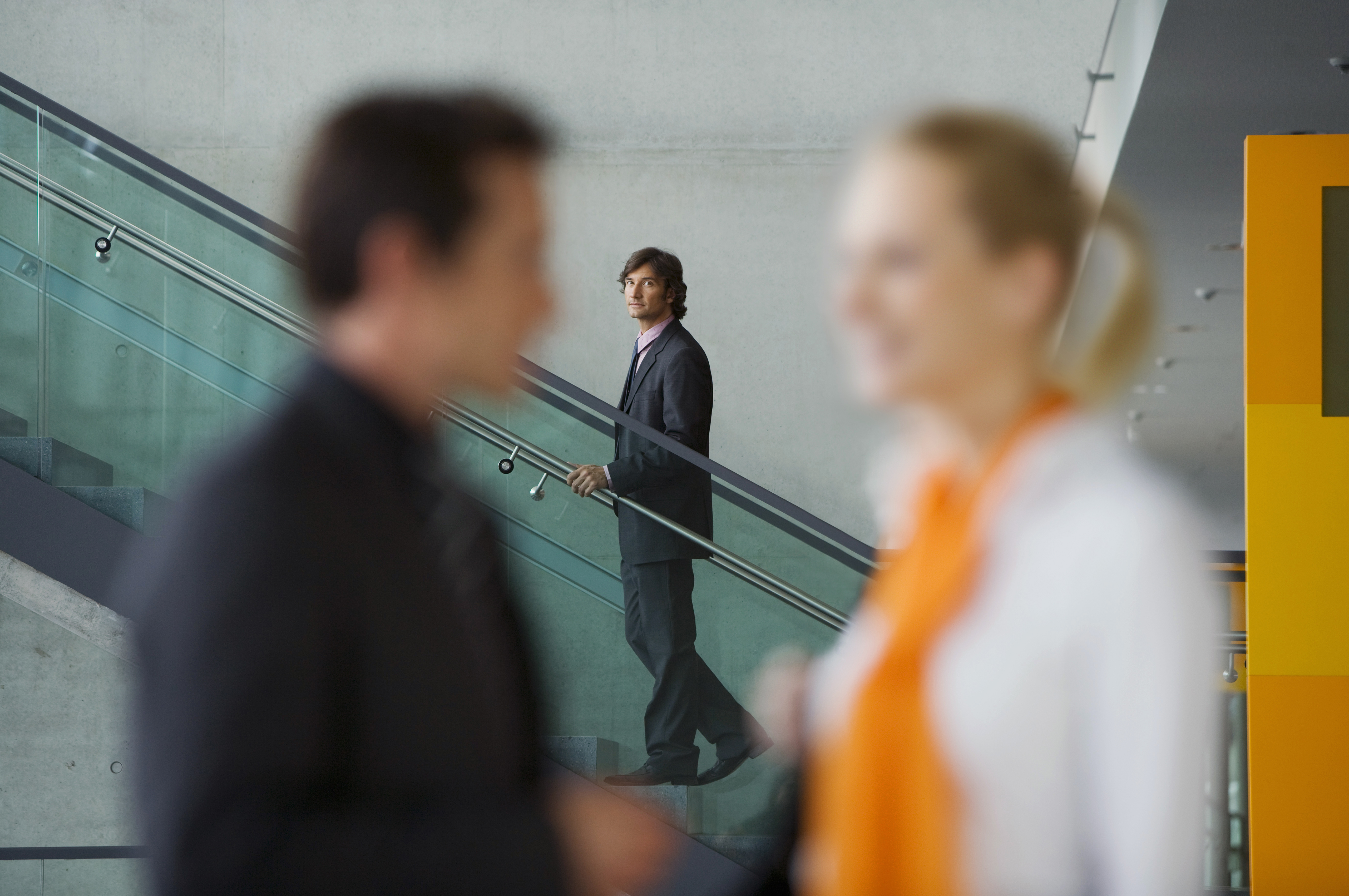 Businessman watching couple talk