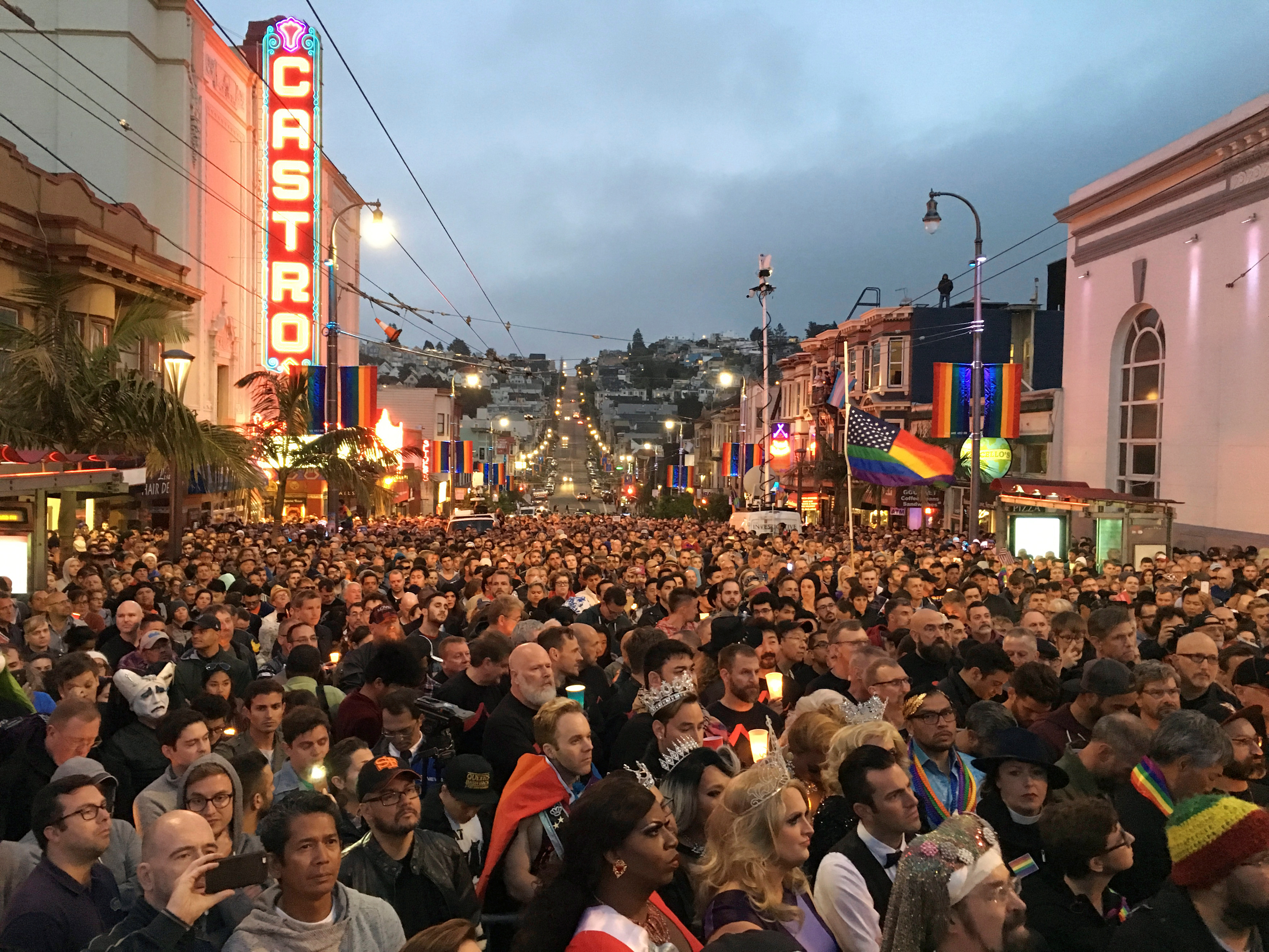 People gather in the Castro District for a vigil for the victims of the Orlando shooting at a gay nightclub, in San Francisco