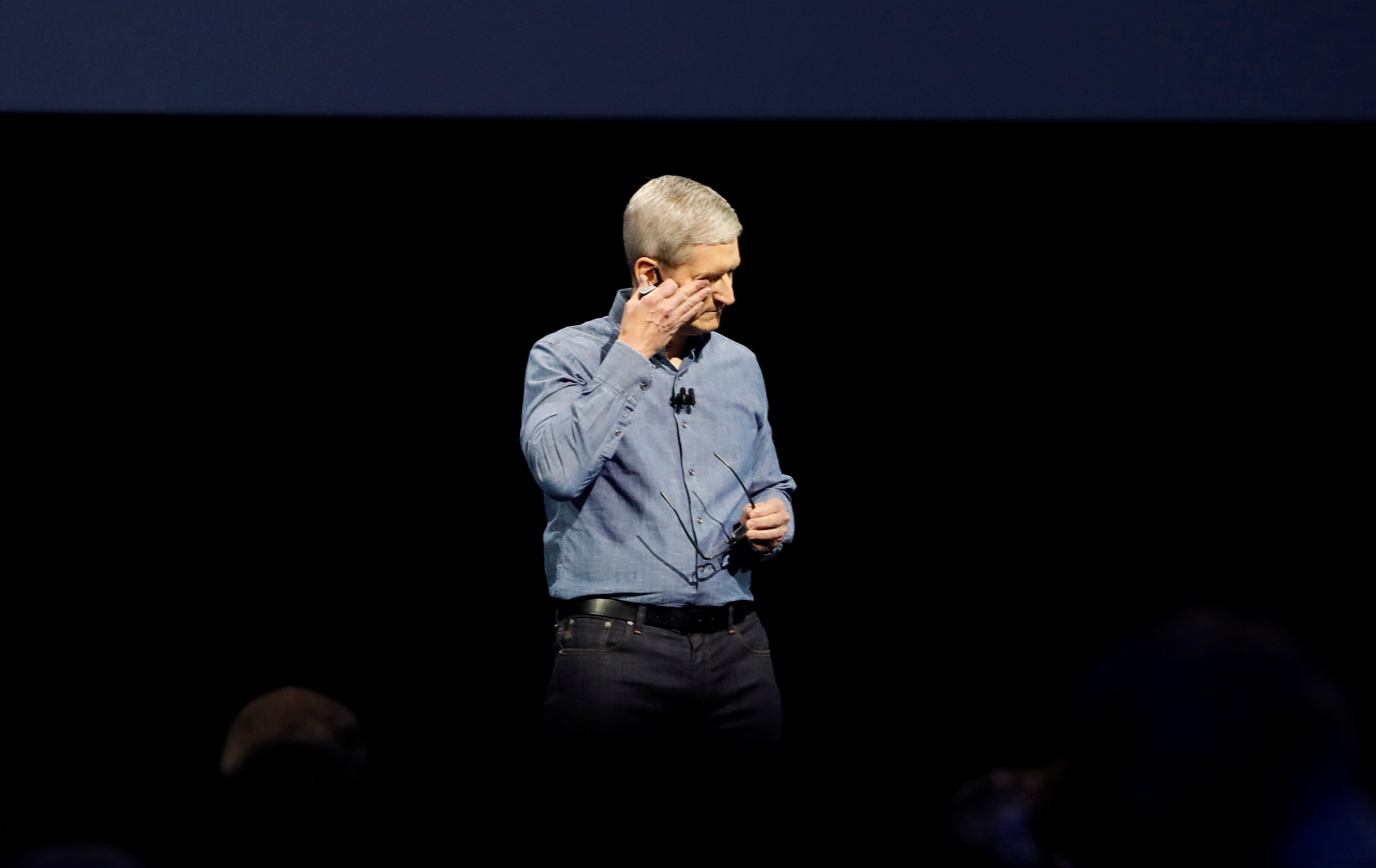Apple Inc. CEO Tim Cook wipes his eyes after leading a moment of silence for the victims of the attack in Orlando as he opens the company's World Wide Developers Conference in San Francisco, California