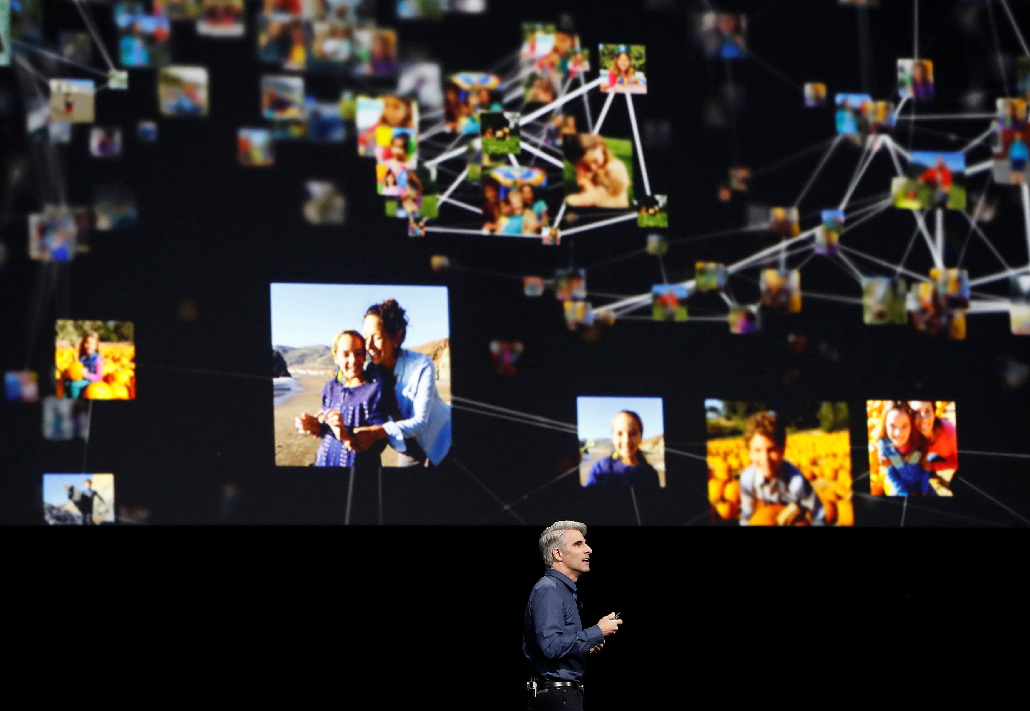 Craig Federighi of Apple Inc. talks about photos within iOS at the company's World Wide Developers Conference in San Francisco, California