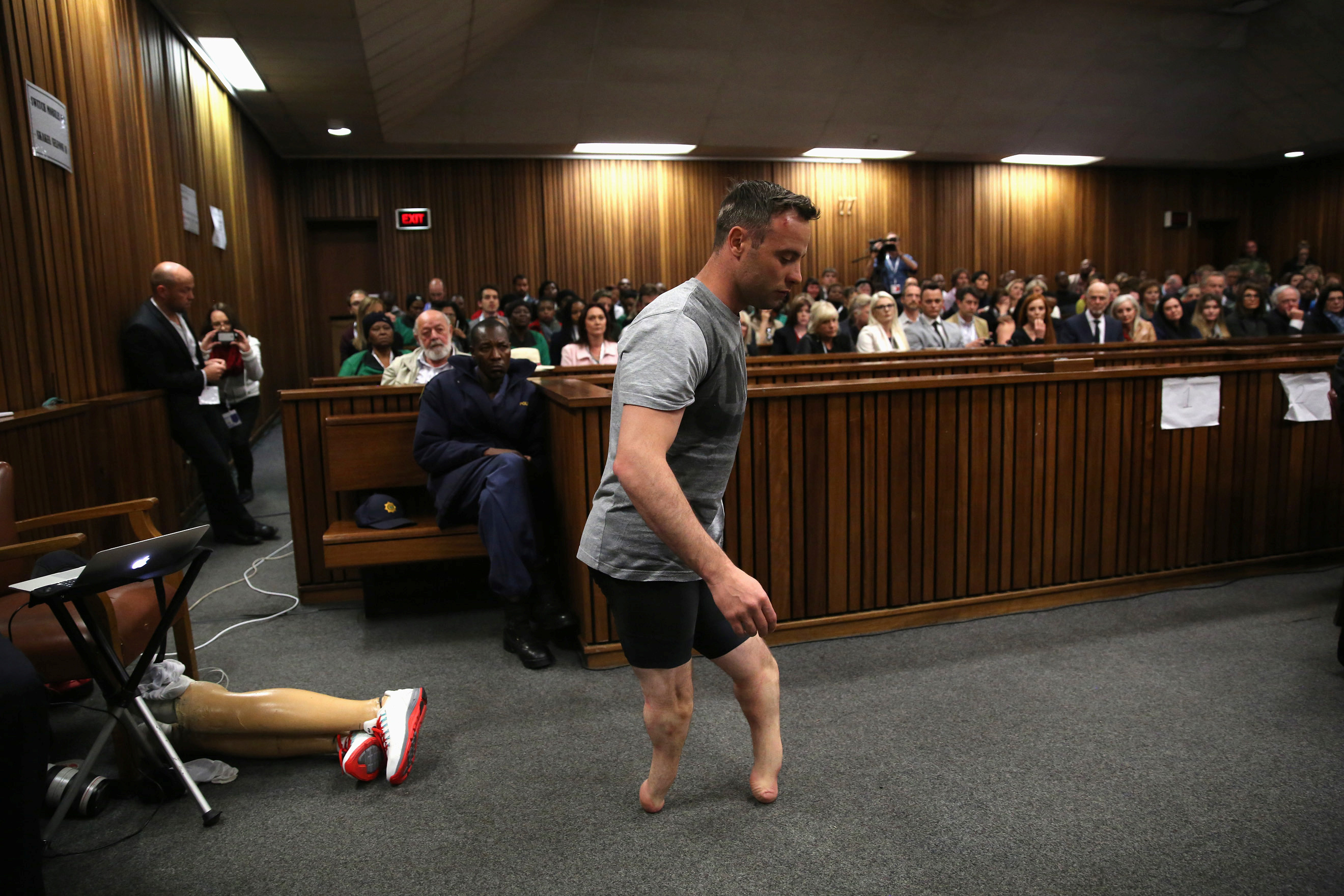 Paralympic gold medalist Oscar Pistorius walks across the courtroom without his prosthetic legs during the third day of the resentencing hearing for the 2013 murder of his girlfriend Reeva Steenkamp, at Pretoria High Court