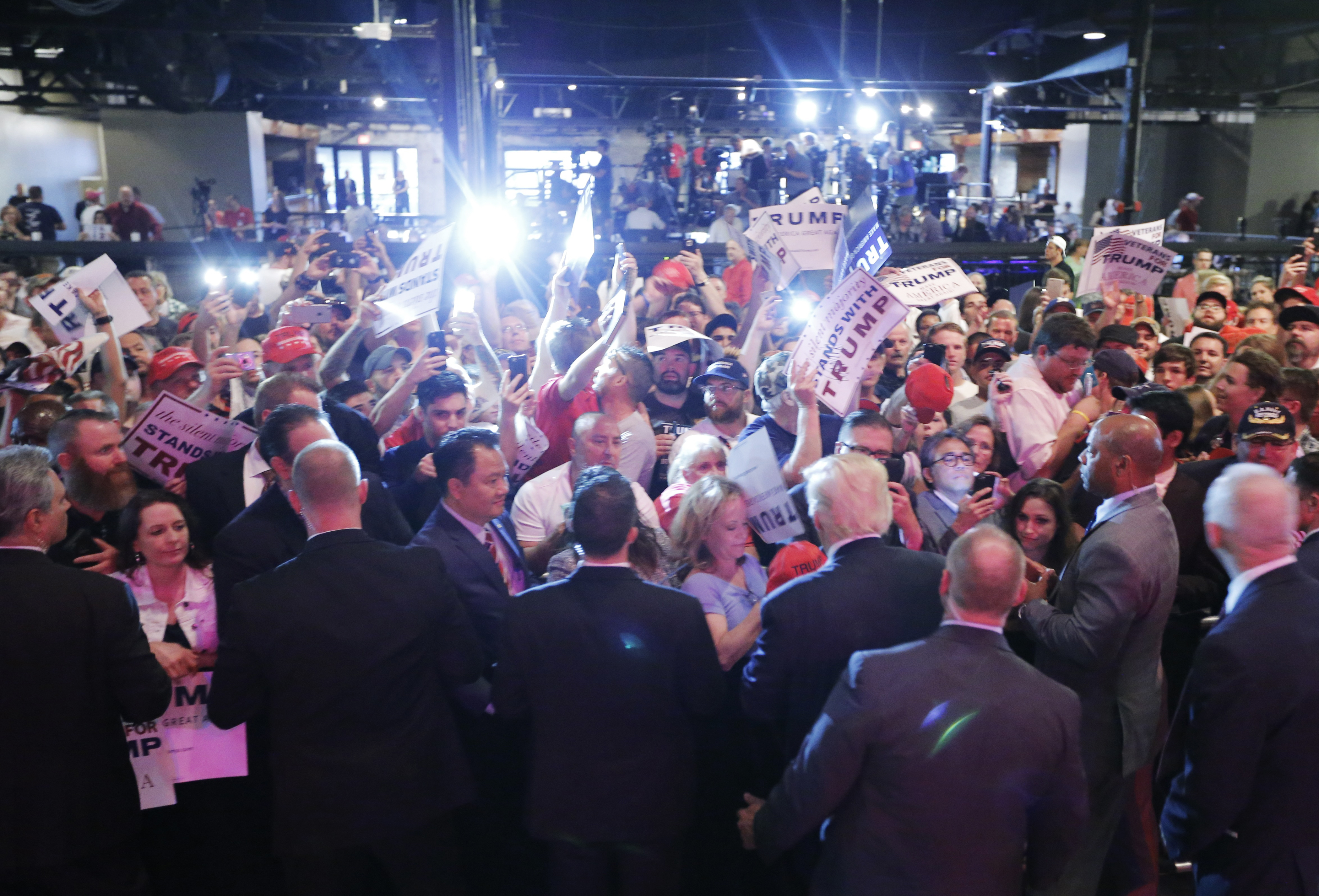 Republican U.S. Presidential candidate Donald Trump greets the crowd at a campaign rally at Gilley's in Dallas