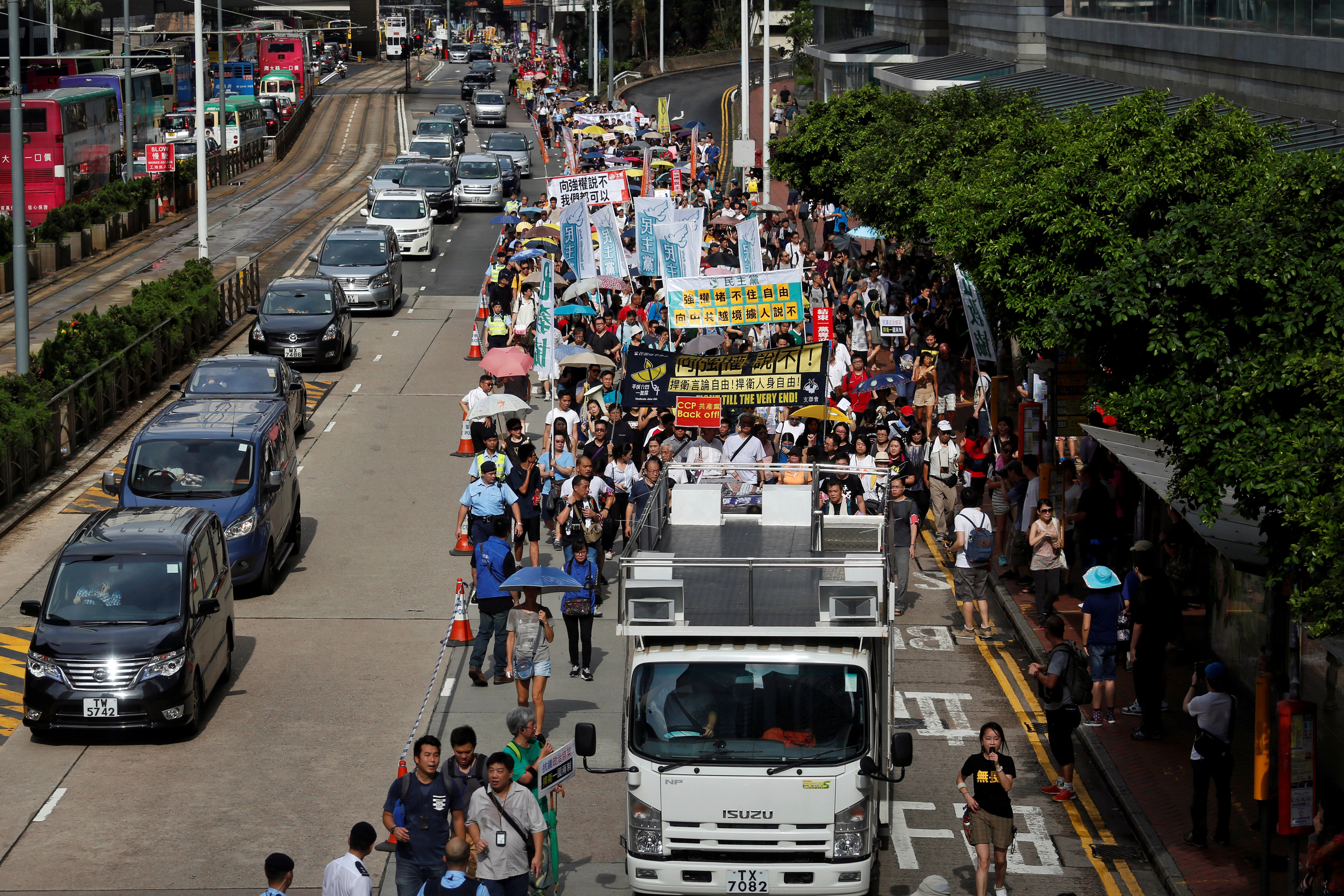 Supporters of bookseller Lam Wing-kee take part in a protest march in Hong Kong